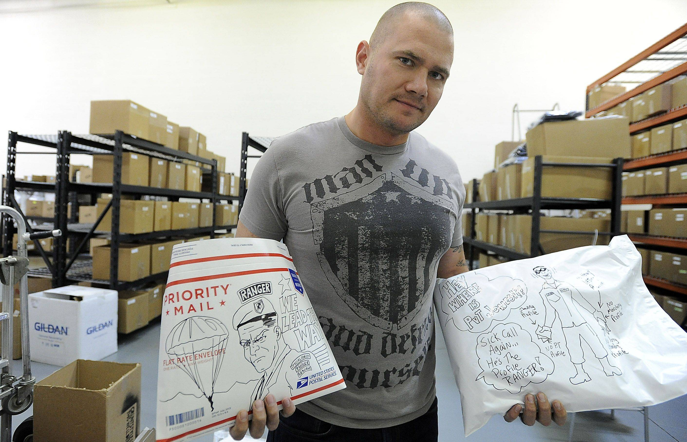 Daniel Alarik, founder and owner of the Grunt Style clothing line in Schaumburg, holds up orders of military-themed products and apparel that are ready to be shipped.