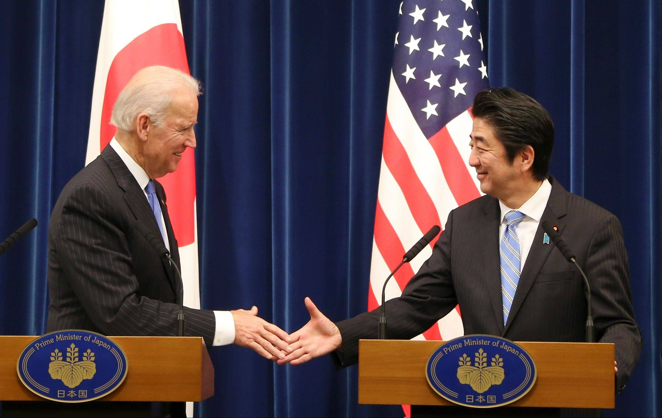 U.S. Vice President Joe Biden shakes hands with Japanese Prime Minister Shinzo Abe at the end of a joint press conference following their meeting at Abe�s official residence in Tokyo Tuesday. Biden voiced strong opposition Tuesday to China�s new air defense zone above a set of disputed islands, showing a united front with an anxious Japan as tension in the region simmered.