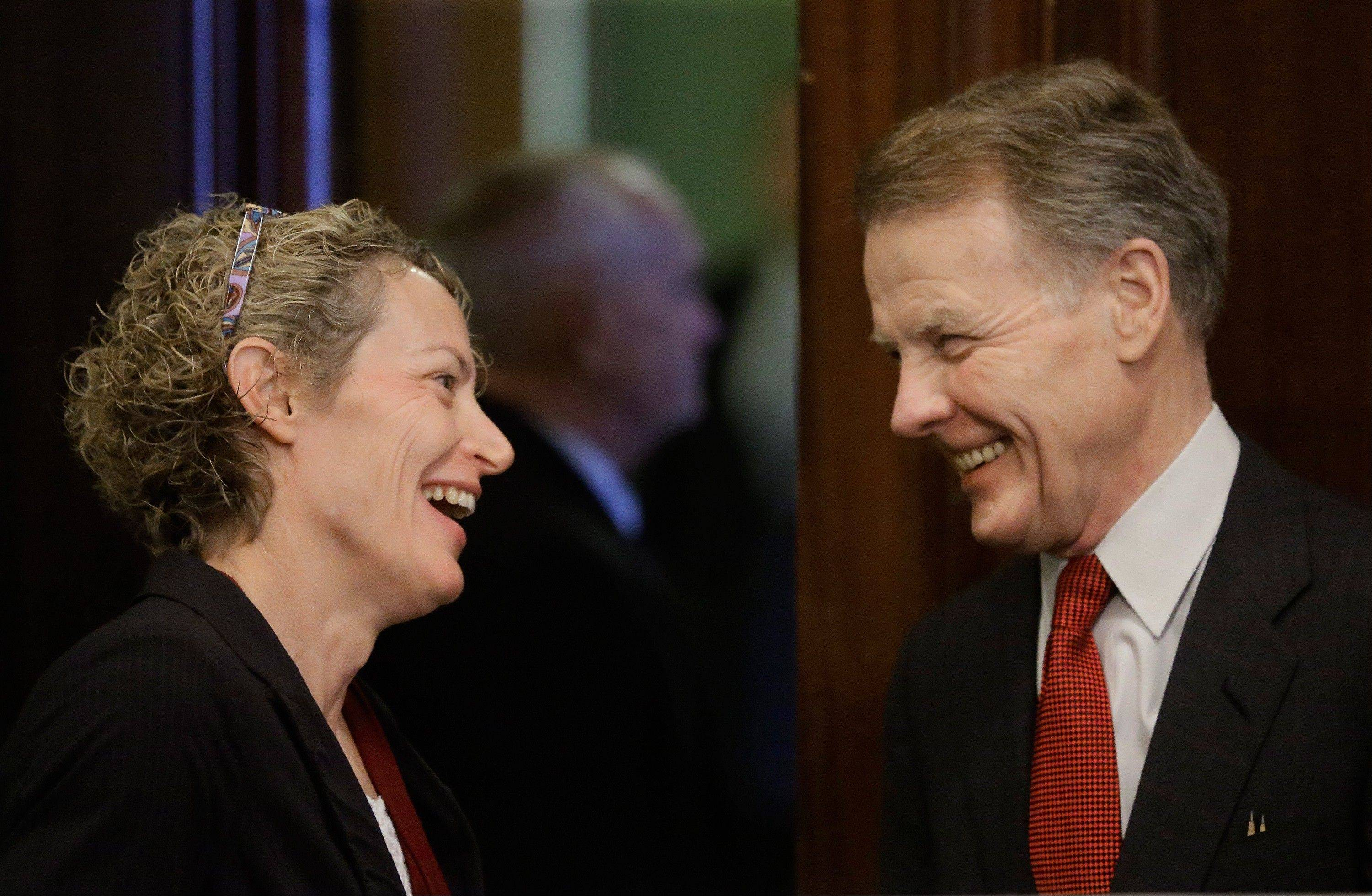 Illinois Speaker of the House Michael Madigan of Chicago, right, and Illinois Rep. Elaine Nekritz of Northbrook talk during a Pension Committee hearing today at the Illinois State Capitol.