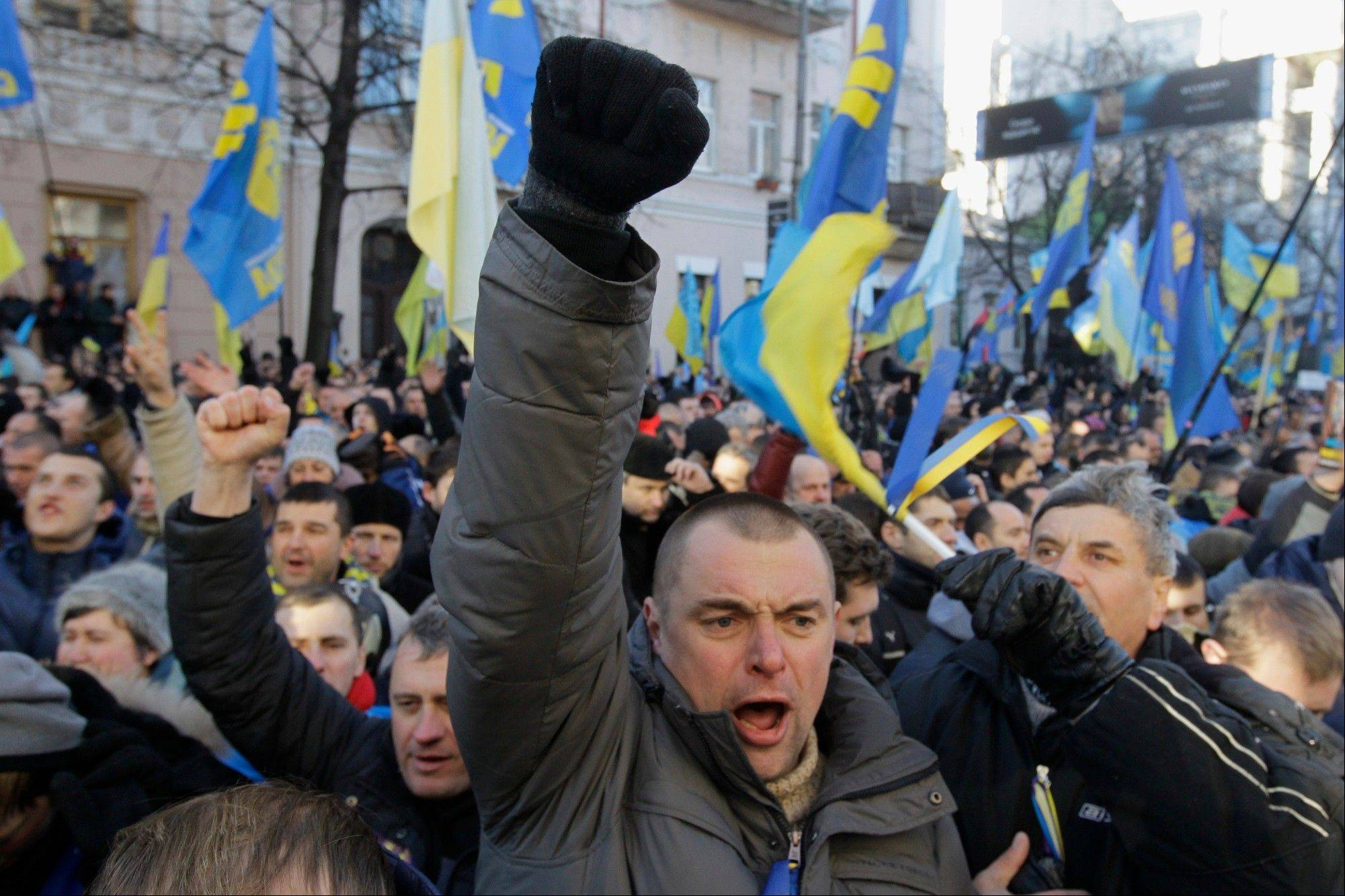 Protesters chant slogans outside the Parliament in Kiev, Ukraine, on Tuesday, Dec. 3, 2013.