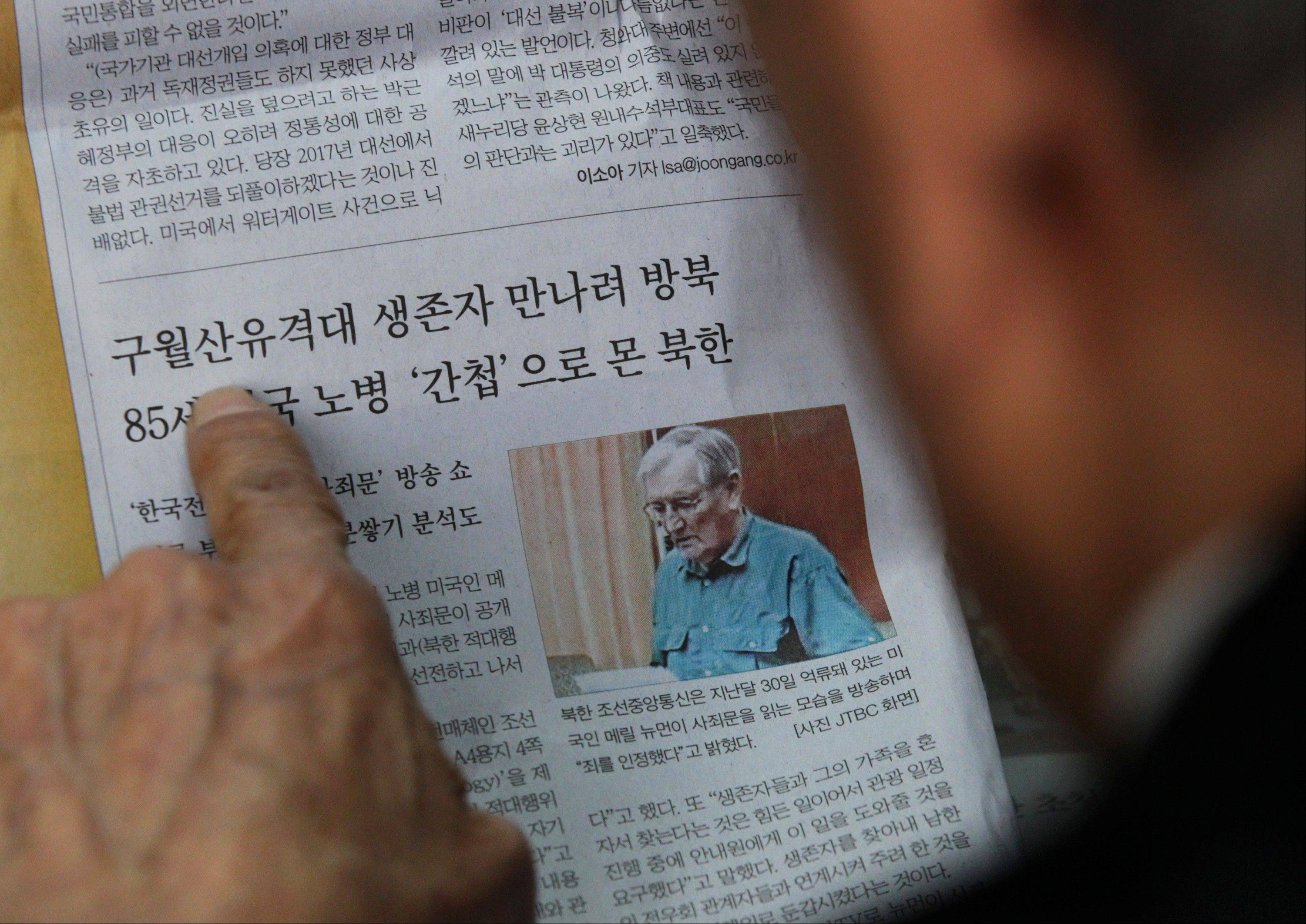 A former member of the Kuwol partisan unit, reads a newspaper reporting on Merrill Newman, an elderly American tourist detained in North Korea, at the Kuwol partisan unit association office in Seoul, South Korea.