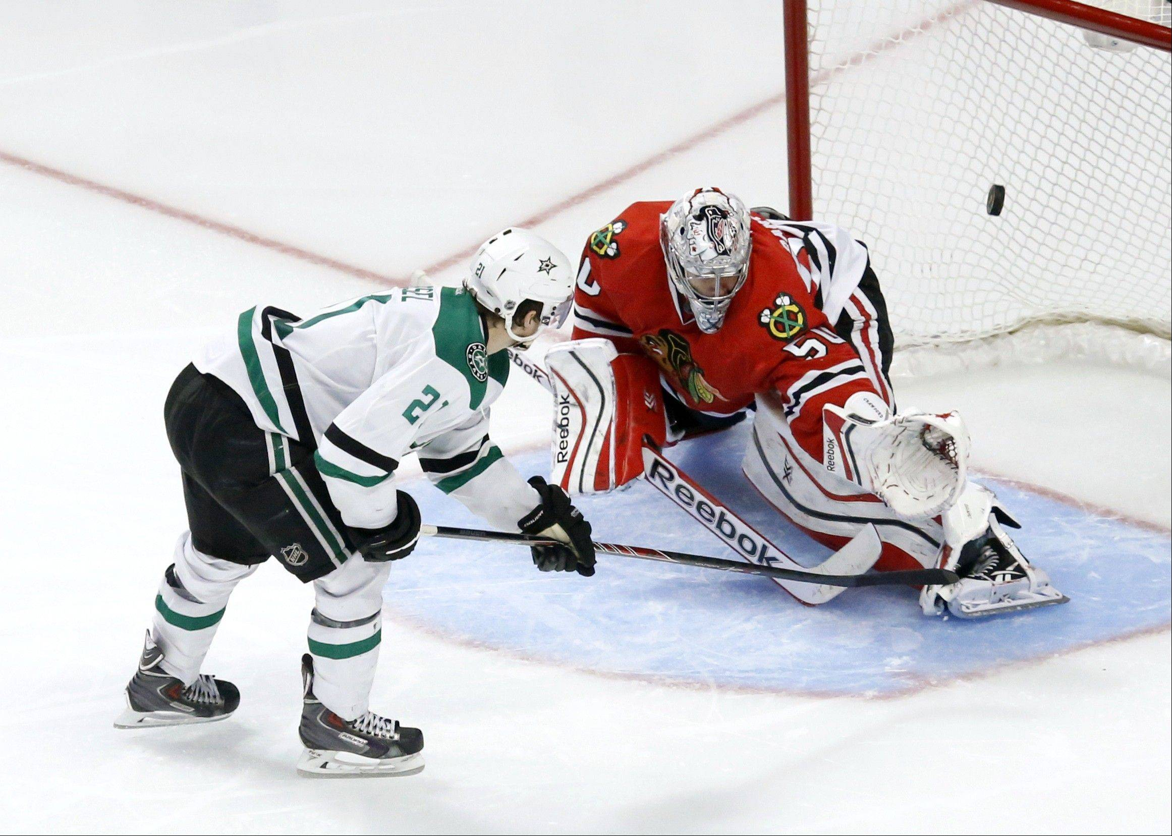 The Stars' Antoine Roussel scores past Blackhawks goalie Corey Crawford on a penalty shot for the game-deciding goal in the third period Tuesday night.
