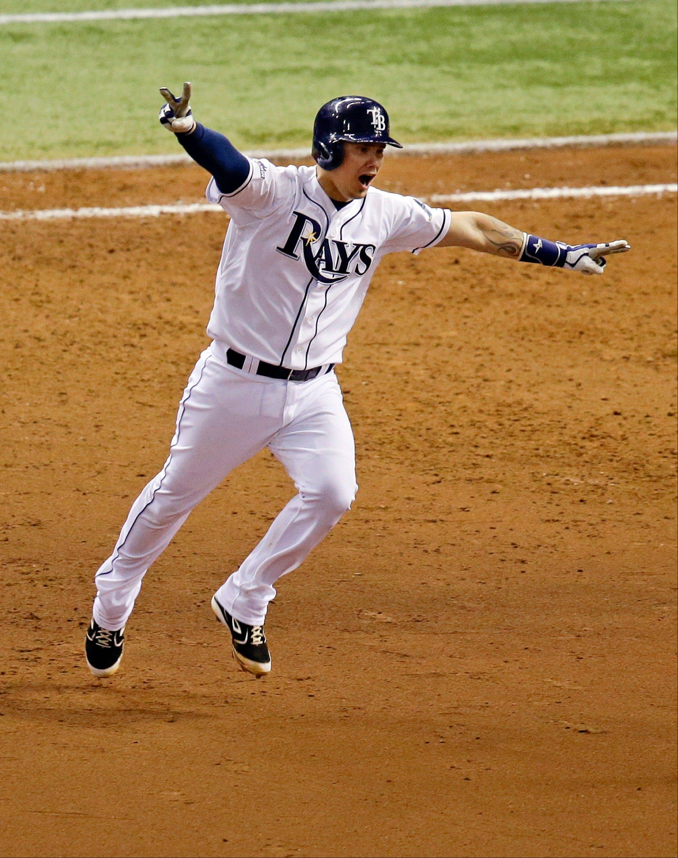 The White Sox reportedly are involved in trade talks with the Tampa Bay Rays about bringing catcher Jose Lobaton to the South Side. Here, Lobaton celebrates a ninth-inning home run against the Red Sox to win Game 3 of an American League division series in October.
