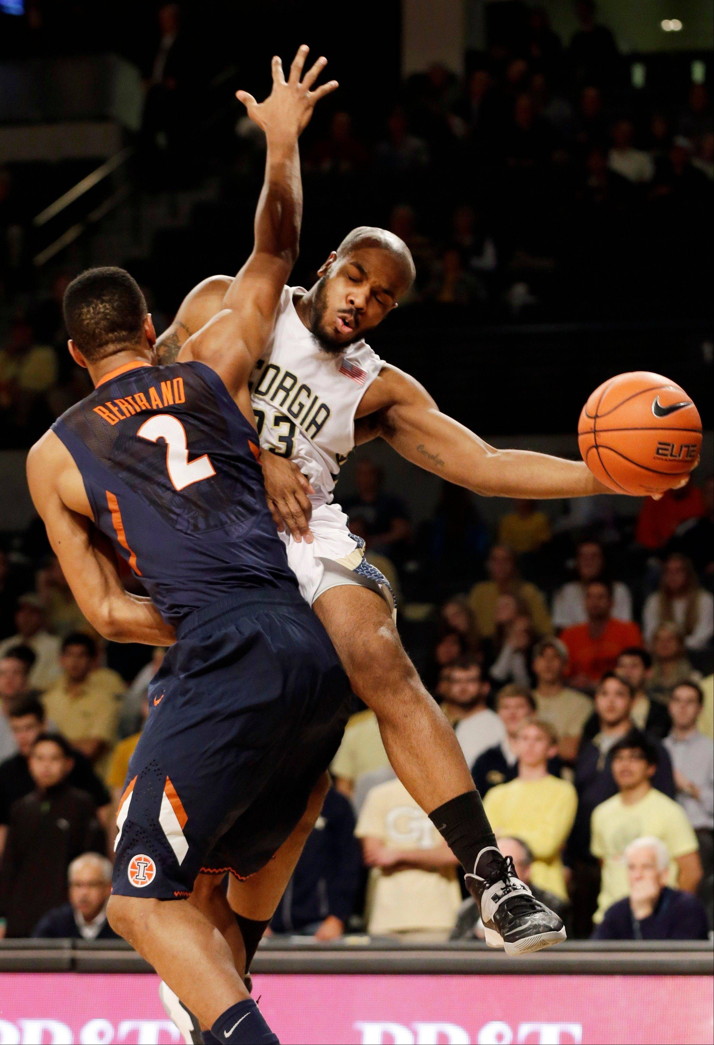 Georgia Tech guard Trae Golden, right, passes the ball as Illinois guard Joseph Bertrand (2) defends during Tuesday�s game in Atlanta. The Illini suffered their first loss of the season, 67-64.