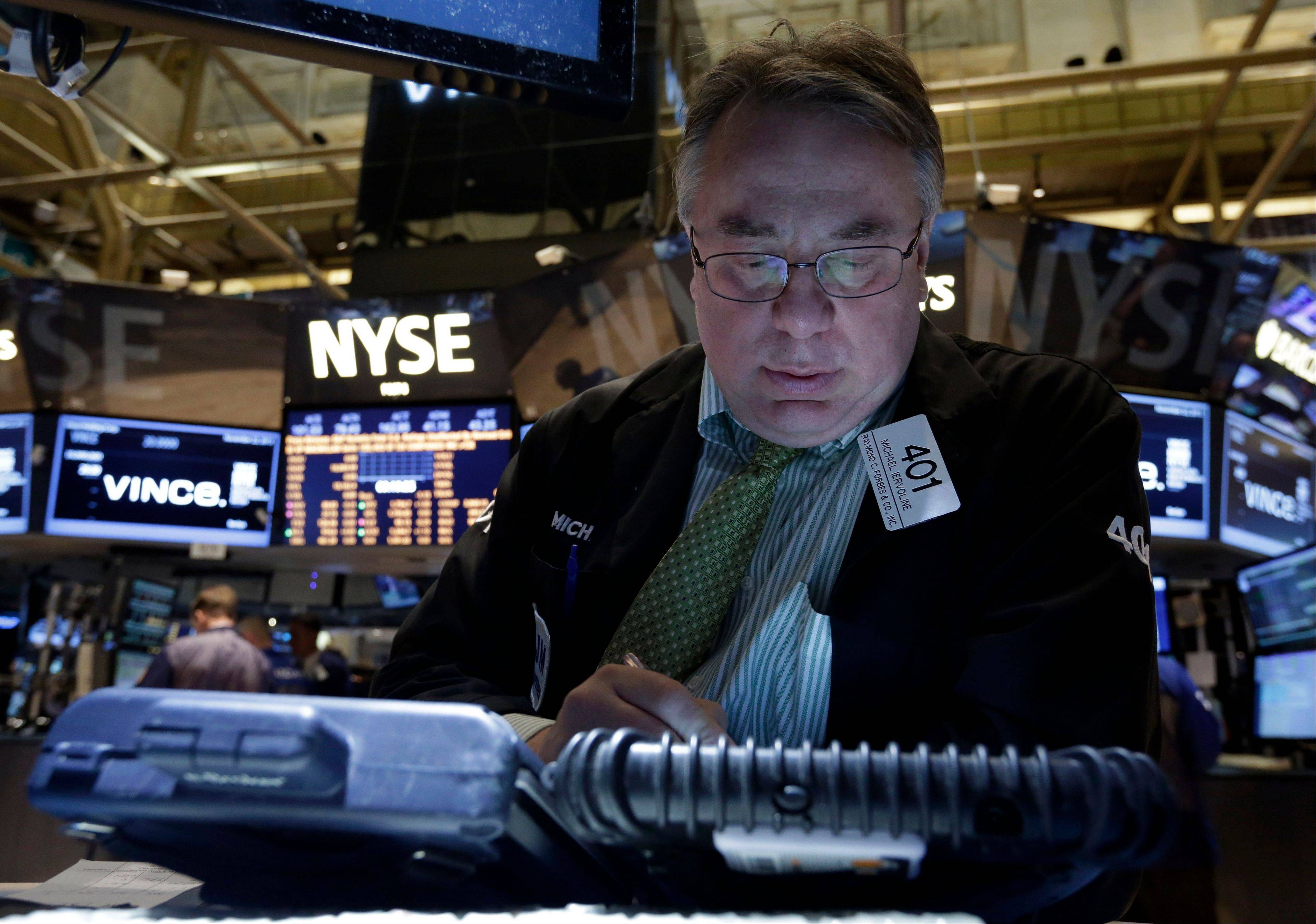 U.S. stocks declined for a third day Tuesday, as investors assessed reports on car and retail sales before economic data this week that may offer clues on when the Federal Reserve will reduce stimulus.