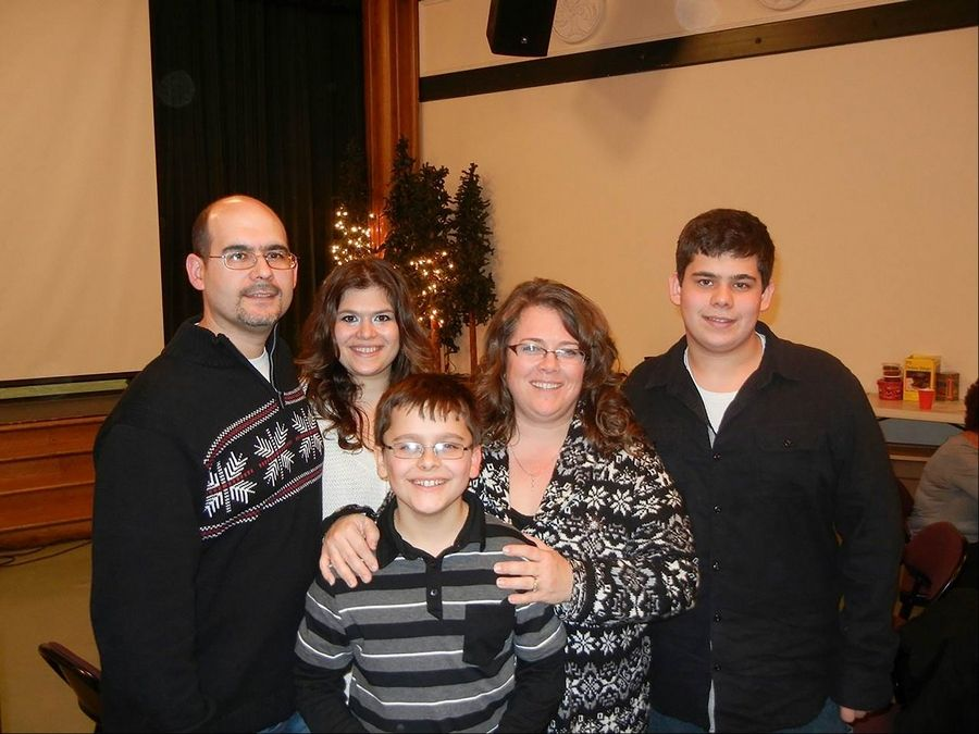 South Elgin resident Bob Mandarino, left, is pictured with his family -- Alyssa, left, Joey, Robyn and Zack. Three years ago, they struggled to celebrate the holidays while Alyssa battled kidney disease. Now, Mandarino leads a team who spreads gifts and cheer to children hospitalized during the holidays.