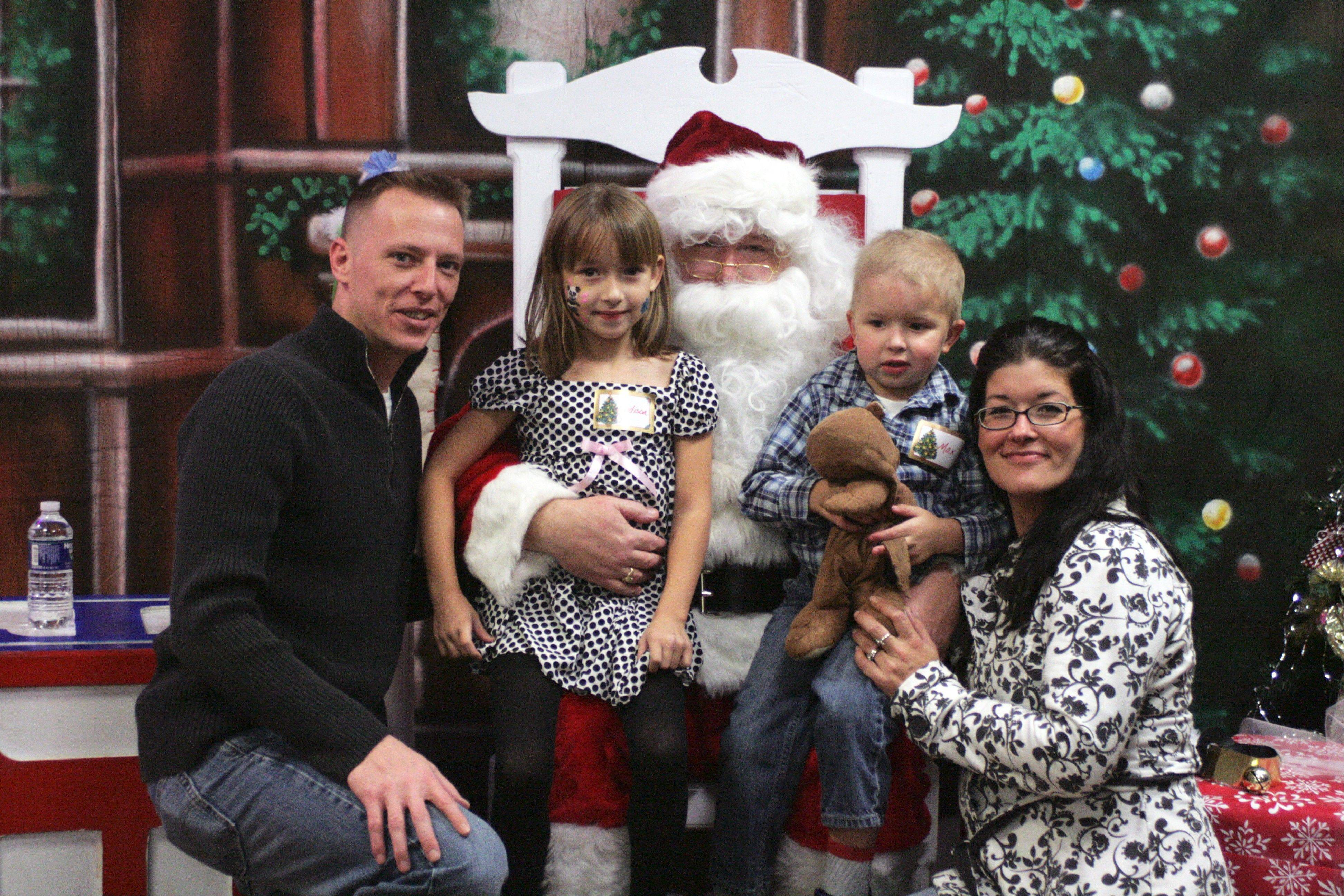 A local family poses for a picture with Santa during their child's stay at Cadence Health Central DuPage Hospital in Winfield.