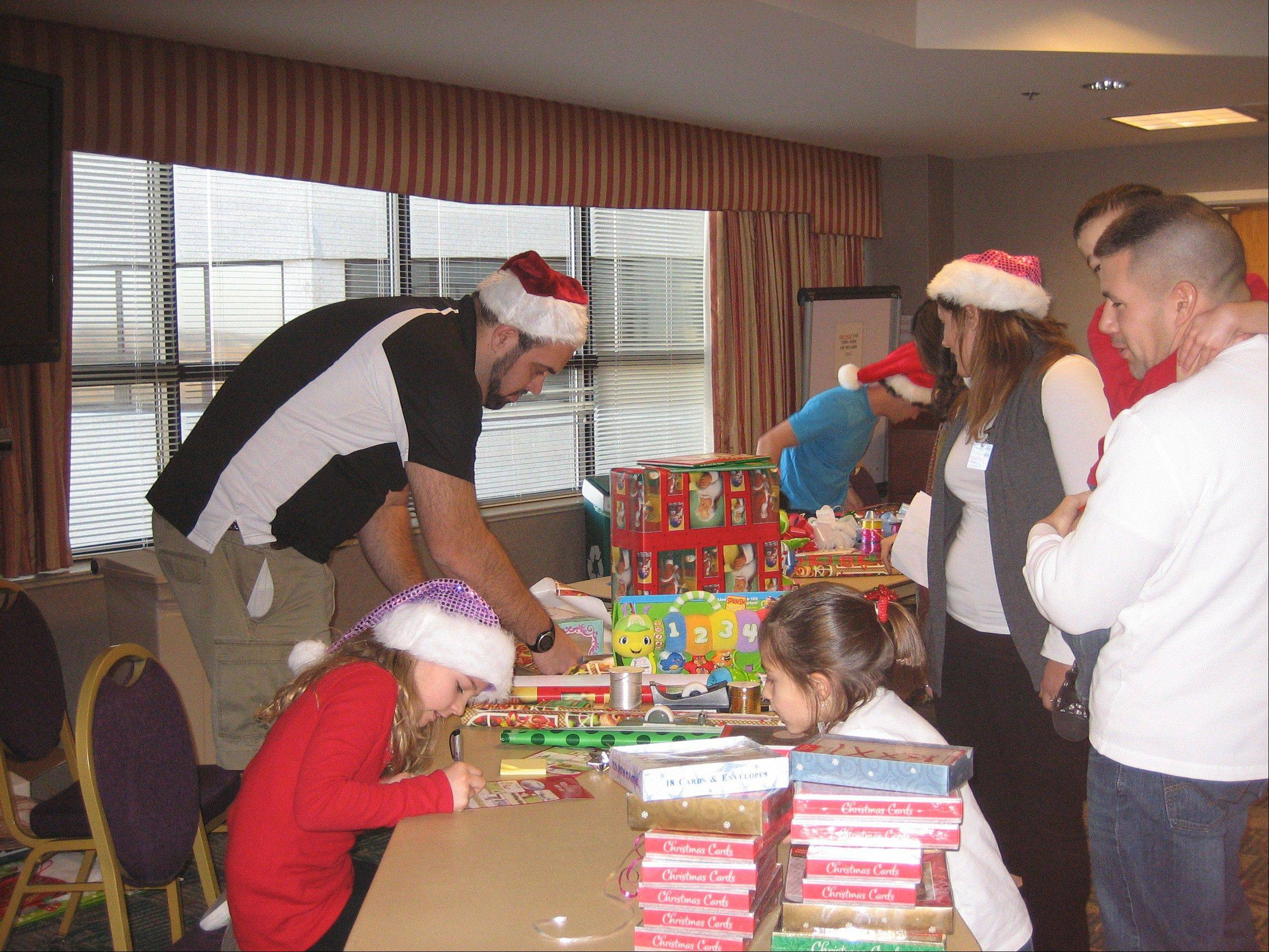 Volunteers at Alexian Brothers Women and Children's Hospital in Hoffman Estates help families select and wrap the perfect gift for hospitalized children and their siblings.