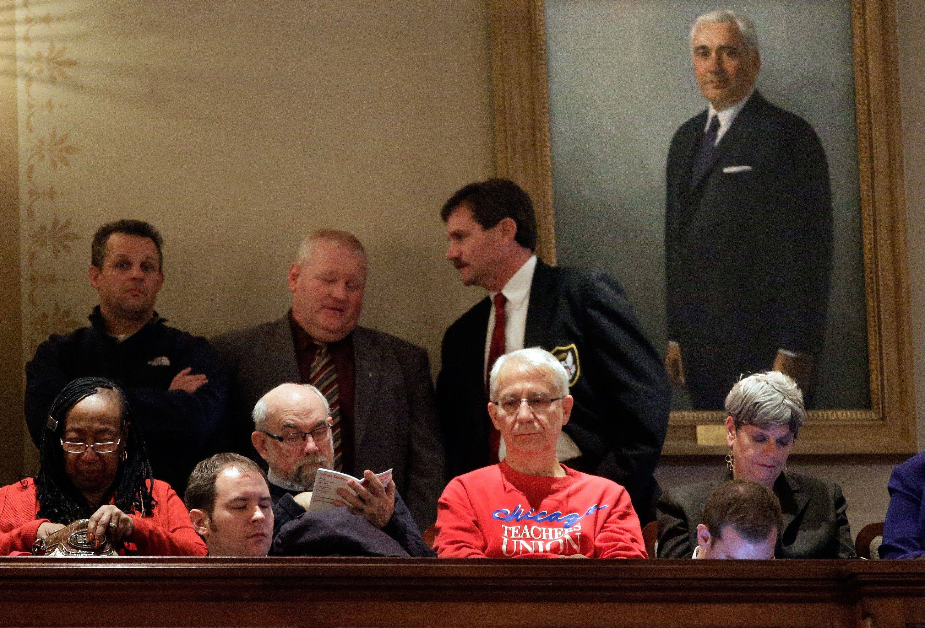 Opponents and supporters watch and listen from the gallery as Illinois House Speaker Michael Madigan argues pension legislation today on the House floor at the state Capitol.