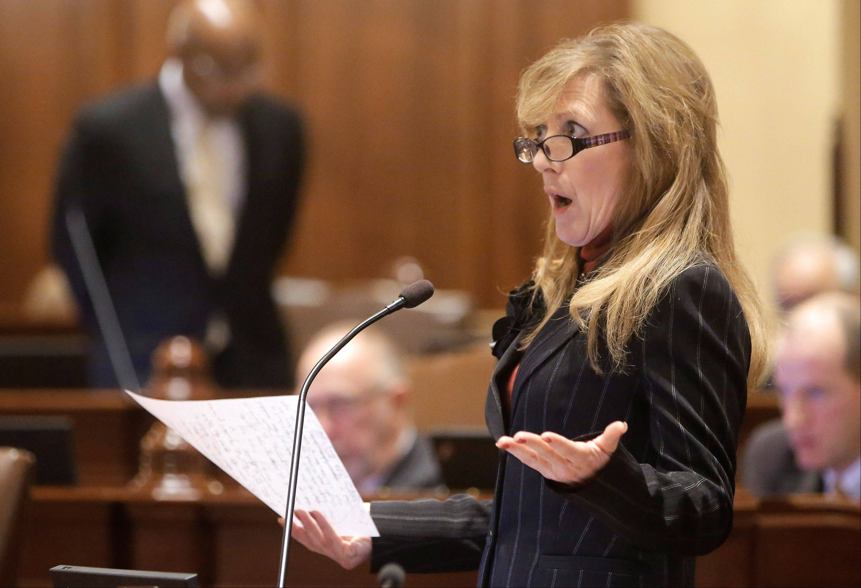 Illinois Sen. Linda Holmes, D-Aurora, argues pension legislation while on the Senate floor at the Illinois State Capitol Tuesday.