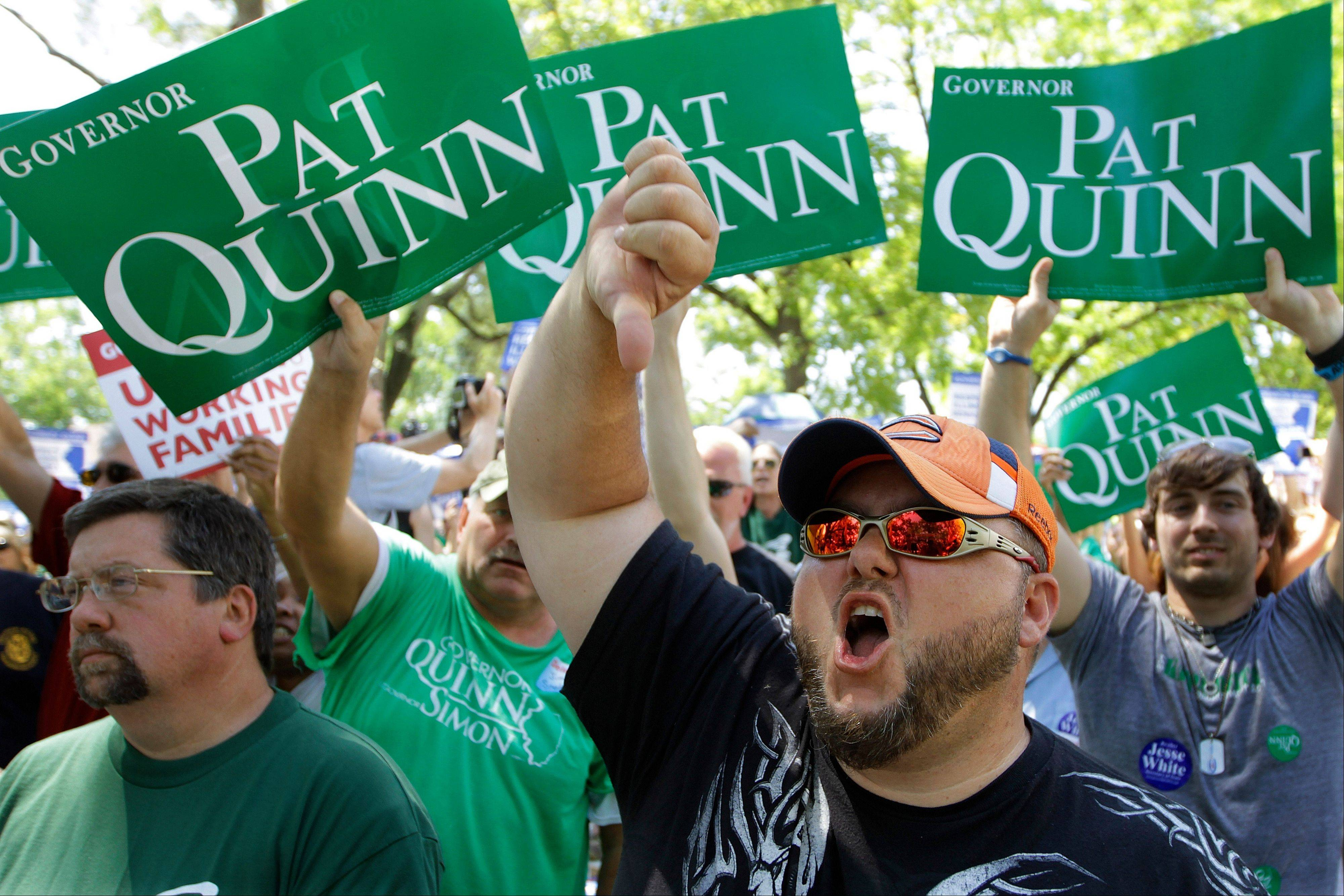 Mike Phillips, and other union protesters, supporters, and labor leaders boo Illinois Gov. Pat Quinn in protest, saying he is betraying the Democratic Party's tradition of supporting working men and women, during Governor's Day at the Illinois State Fair in Springfield.