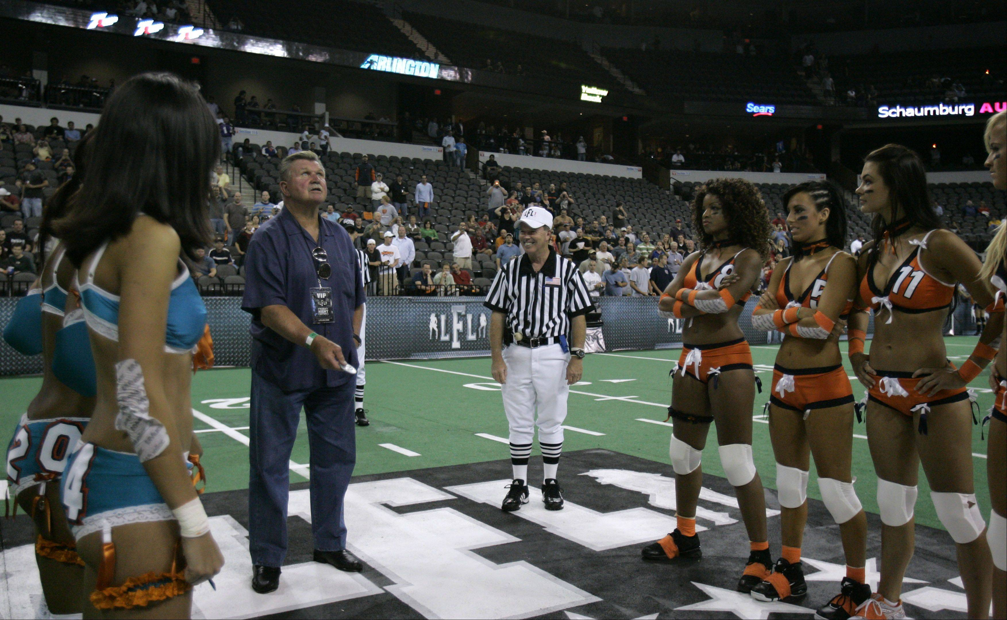 Lending his Ditka fame to the Lingerie Football League, Mike Ditka gets ready to toss the coin before the Chicago Bliss vs. Miami Caliente season opener in 2009.