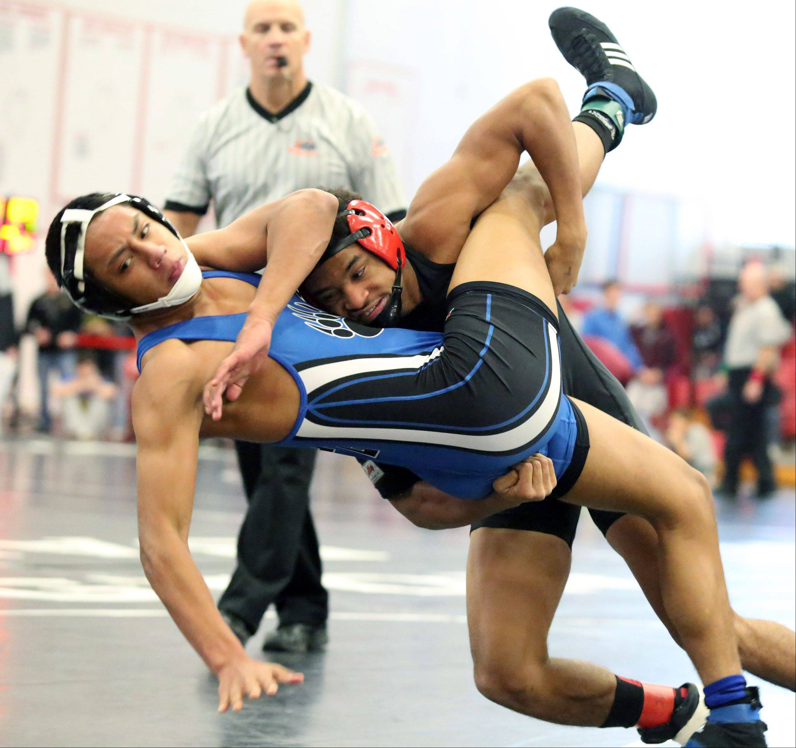 Hinsdale Central's Juwan Edmond, right, wins over Lake Zurich's Brandon Arleaga in the 145-pound semifinals at the 23rd annual Moore/Prettyman wrestling tournament on Saturday in Barrington.