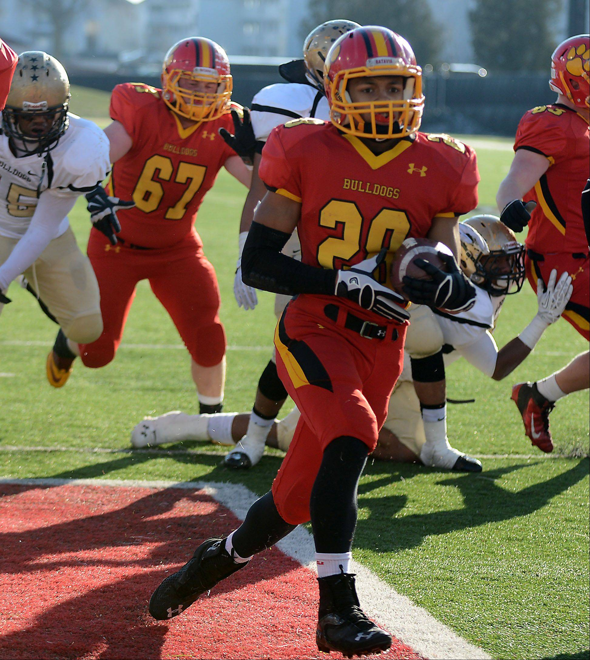 Batavia's Anthony Scaccia (28) runs in a short touchdown during Saturday's Class 6A championship football game in DeKalb.