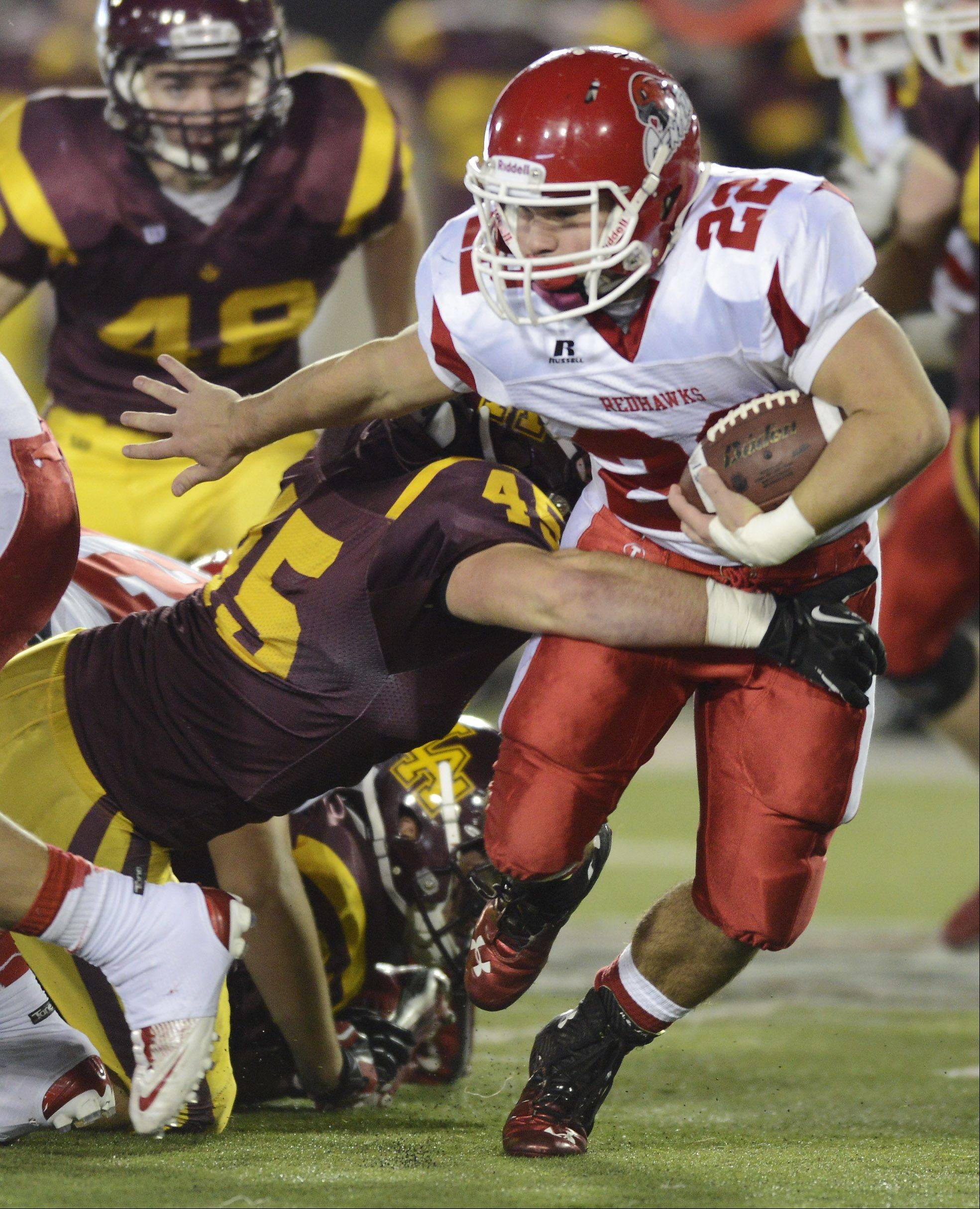 Naperville Central's Kevin Clifford gets past Loyola's Brian O'Brien during the Class 8A football final in DeKalb Saturday.
