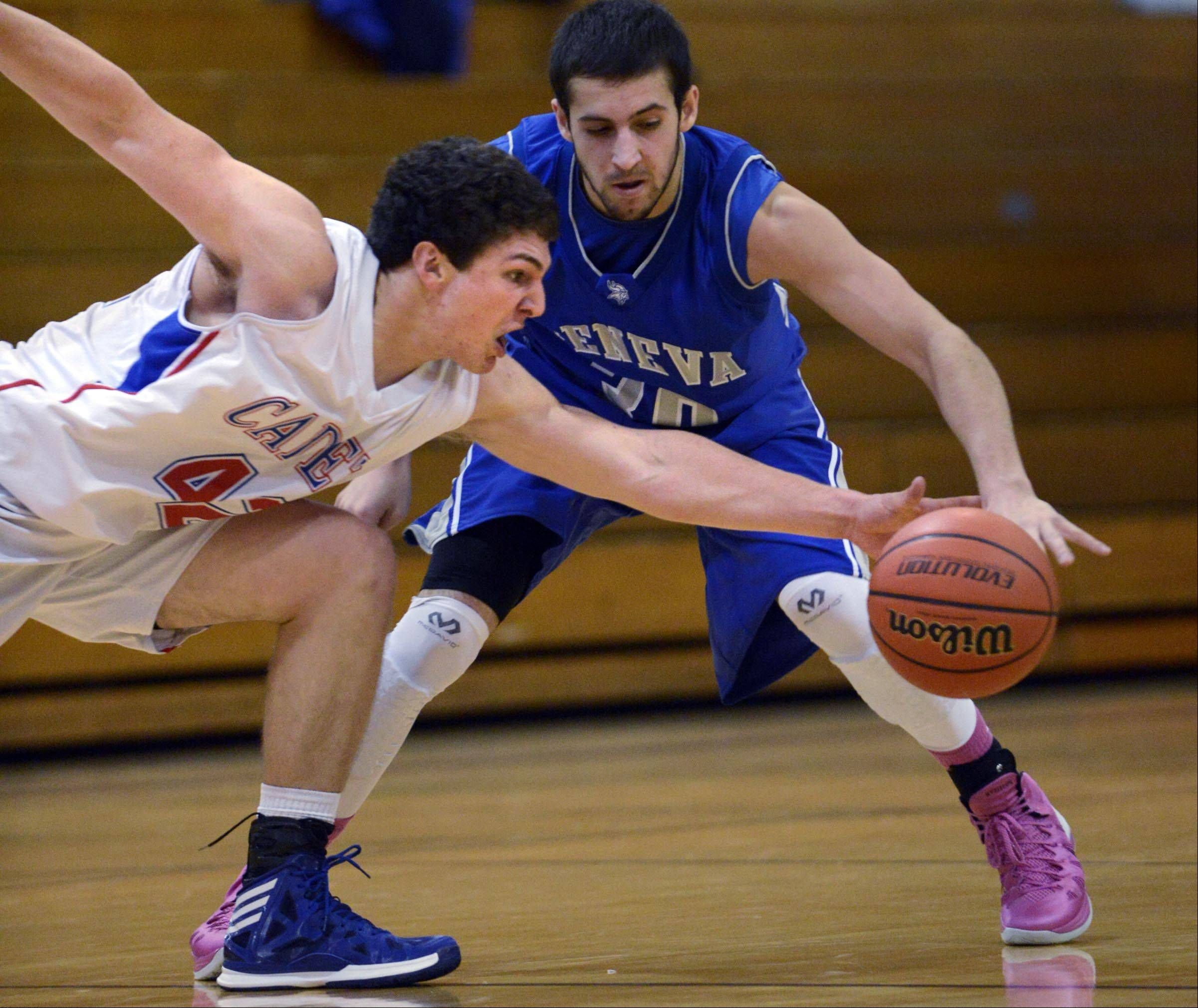 Marmion Academy's Jordan Glasgow, left, steals the ball from Geneva's Chris Parrilli Monday in the Wildcat Turkey Classic in West Chicago.