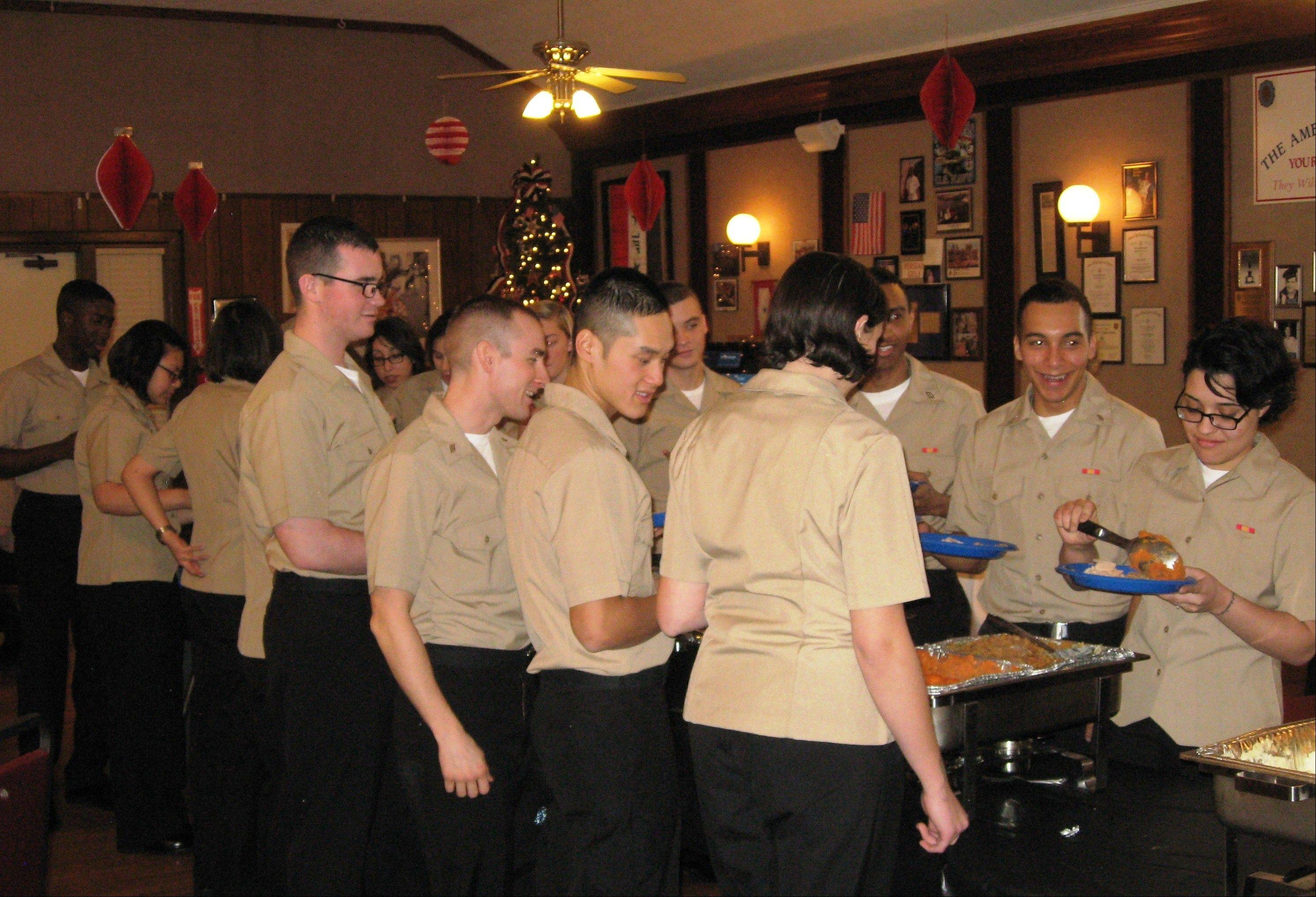Naval recruits from Great Lakes Naval Training Center dig into a Thanksgiving dinner, with all the trimmings, courtesy of American Legion Post 208 in Arlington Heights.