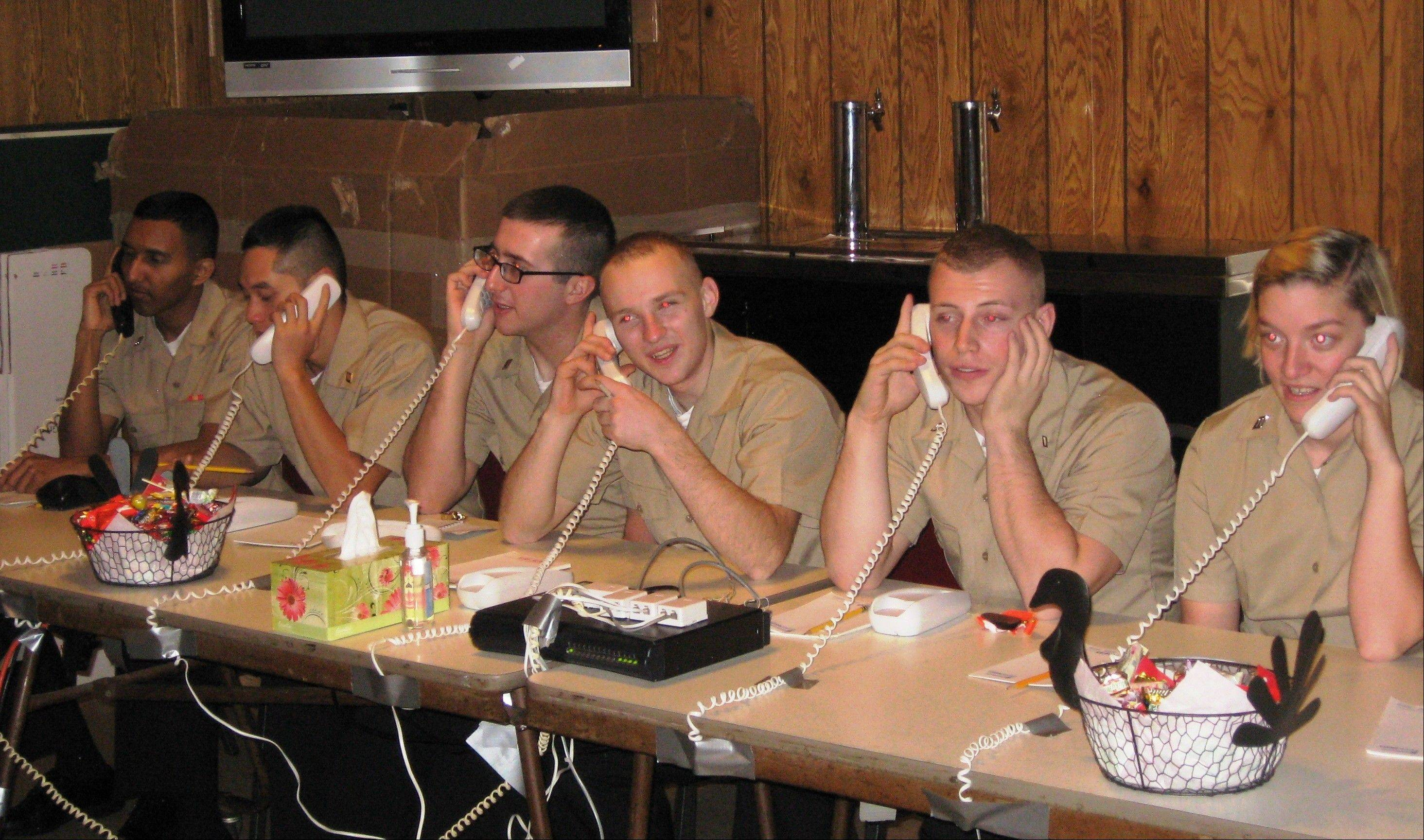 Naval recruits from Great Lakes Naval Training Center makes phone call home on Thanksgiving courtesy of Post 208 in Arlington Heights.