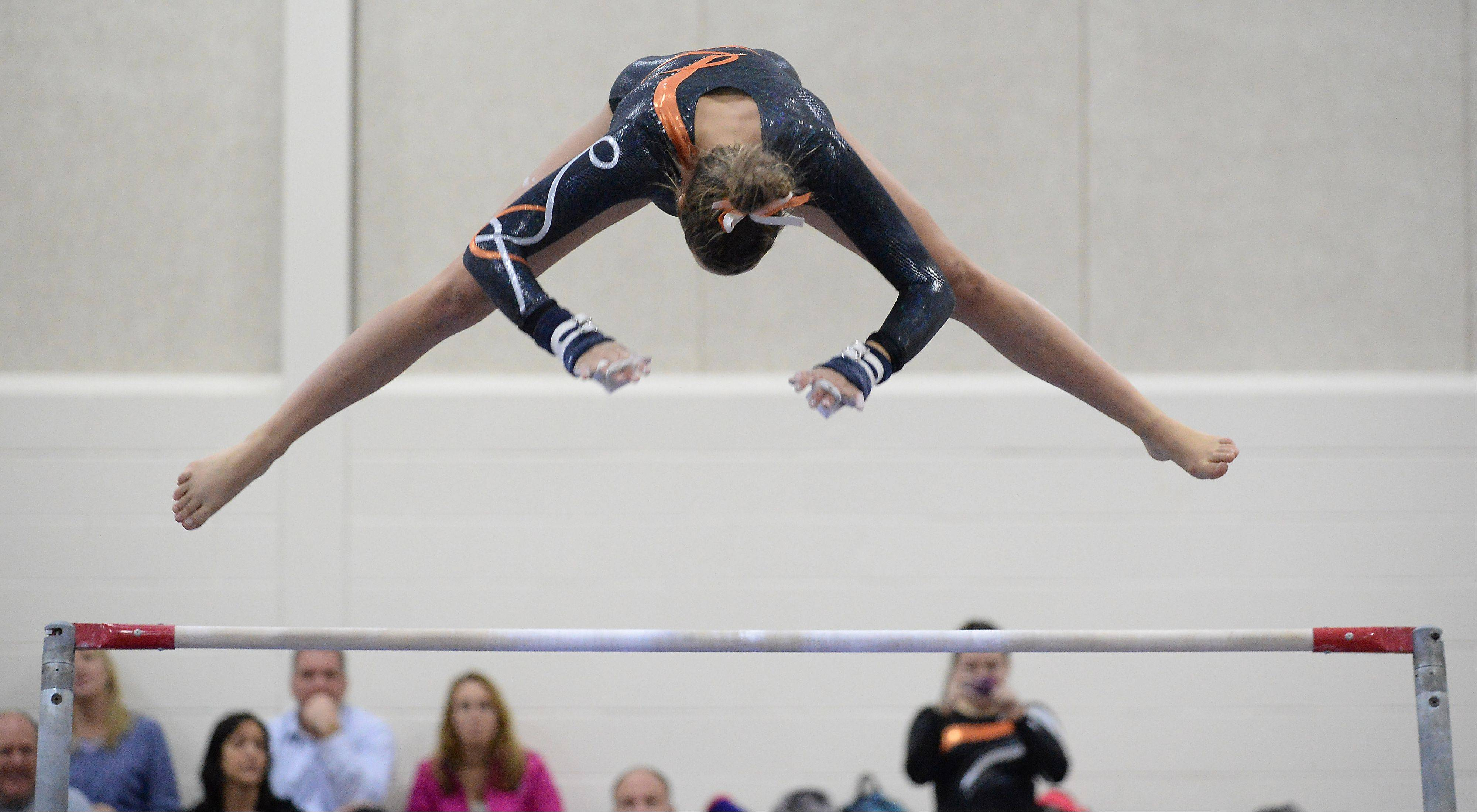 Hersey�s Anne Johnson shows perfect form on the uneven bars at Hoffman Estates on Wednesday.