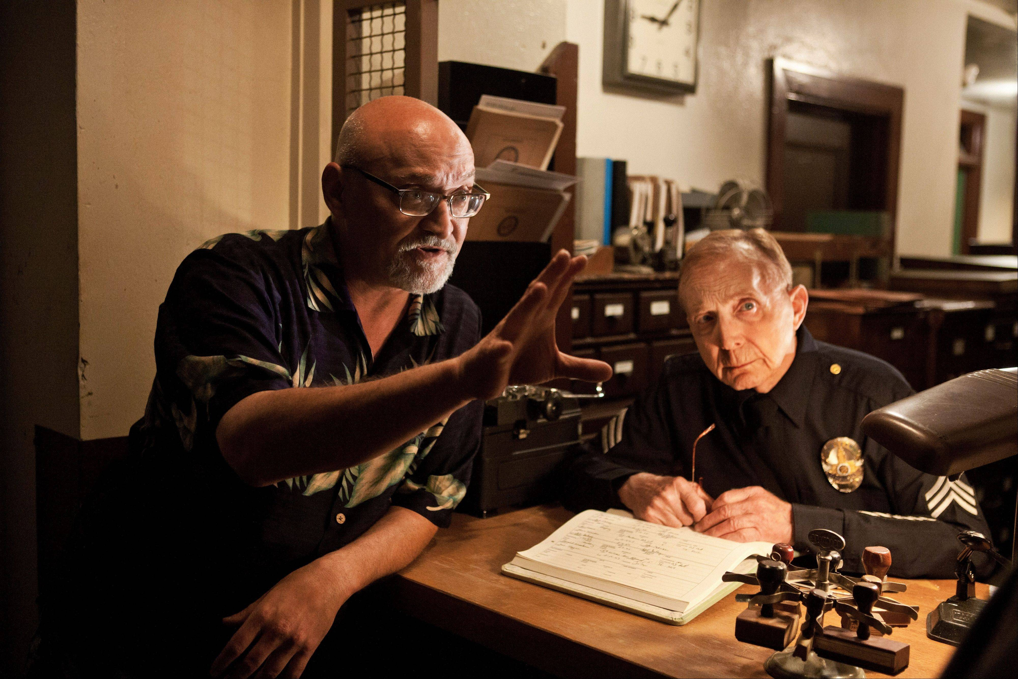 "Frank Darabont, left, with Bix Barnaba, directs a shot during the production of ""Mob City."" The drama series from the writer-director Darabont debuts Wednesday, Dec. 4, for a three-week run."