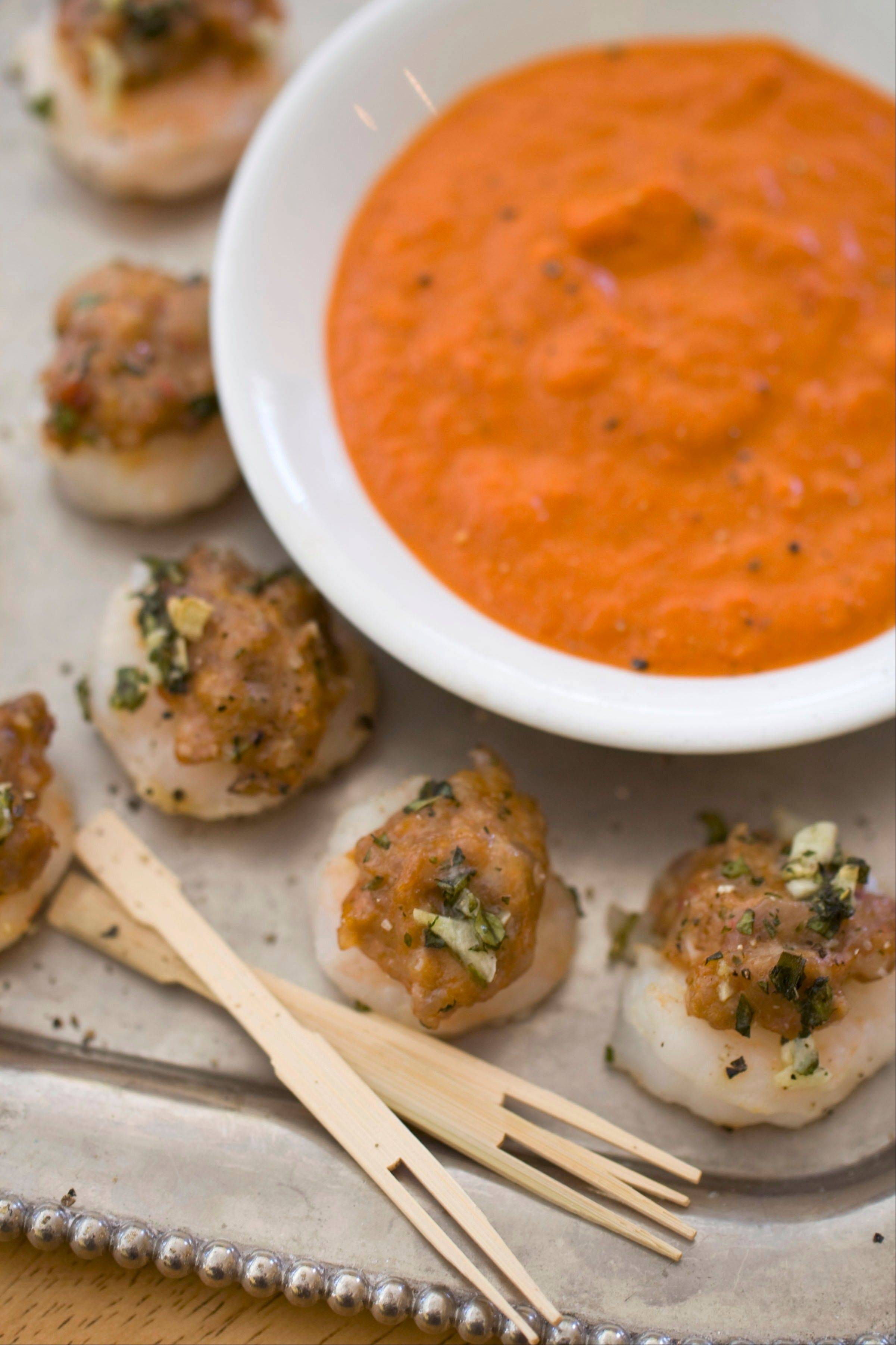 Wrapping shrimp around a nugget of sausage is a clever trick and the proteins bake into the perfect appetizer or hors d'oeuvres for a holiday party.