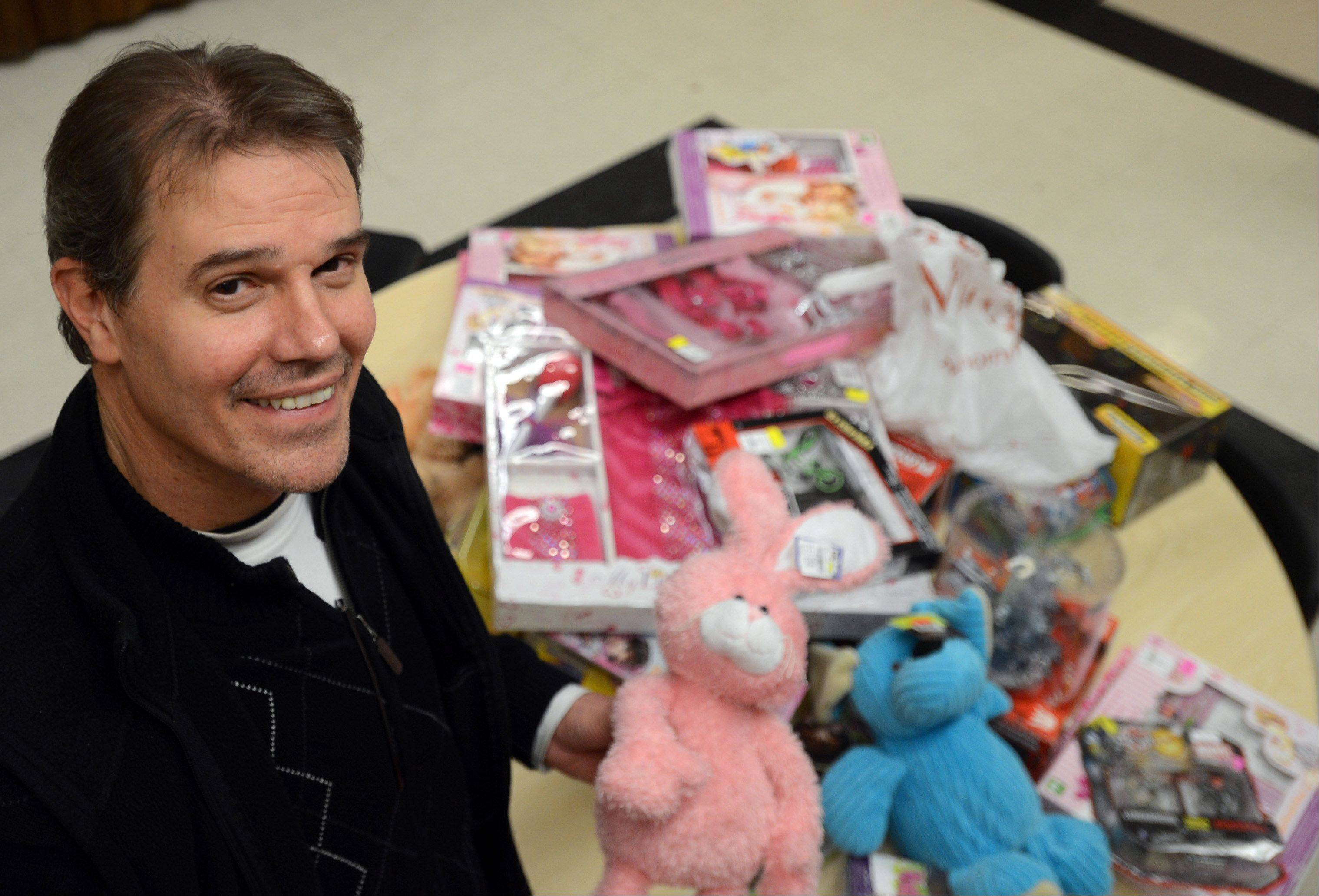 100 Percent Foundation Co-director Frank Davis with some of the toys his organization has gathered this holiday season.