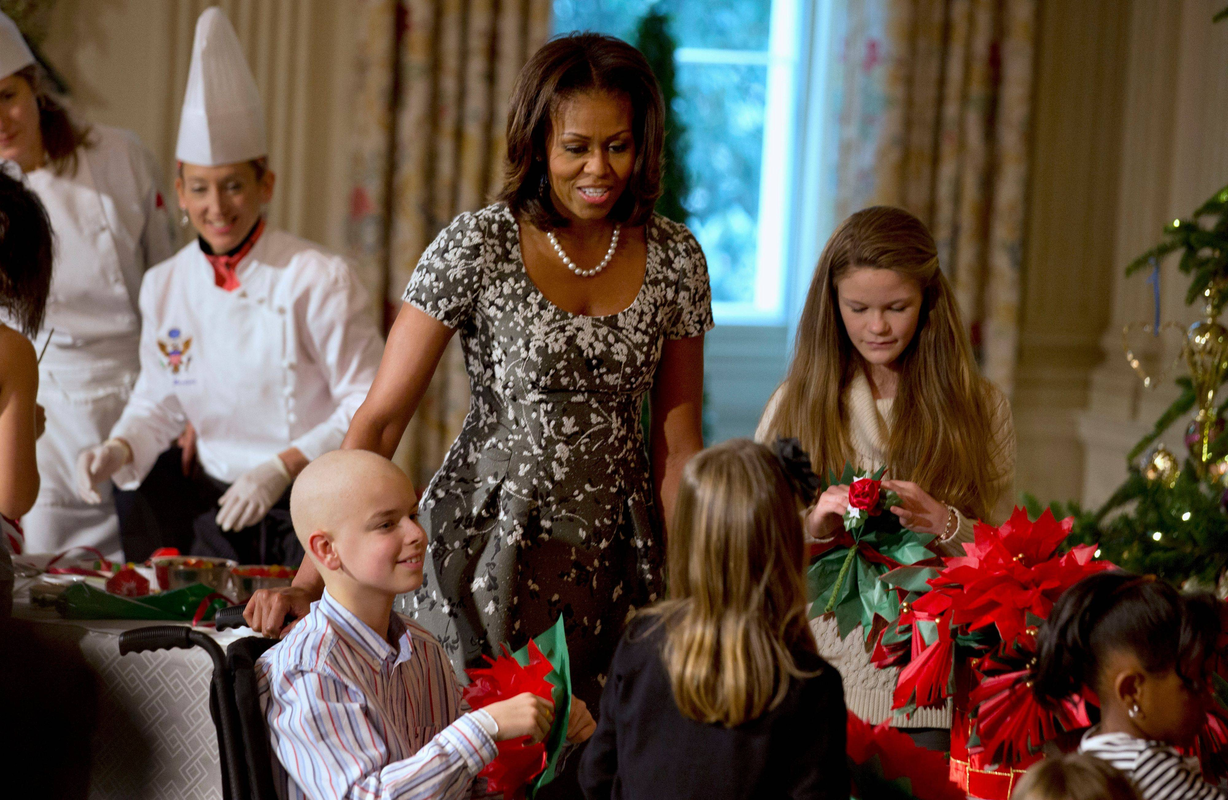 First lady Michelle Obama greets children during a holiday celebration showing the holiday decorations at the White House on Wednesday.$PHOTOCREDIT_ON$ASSOCIATED PRESS$PHOTOCREDIT_OFF$