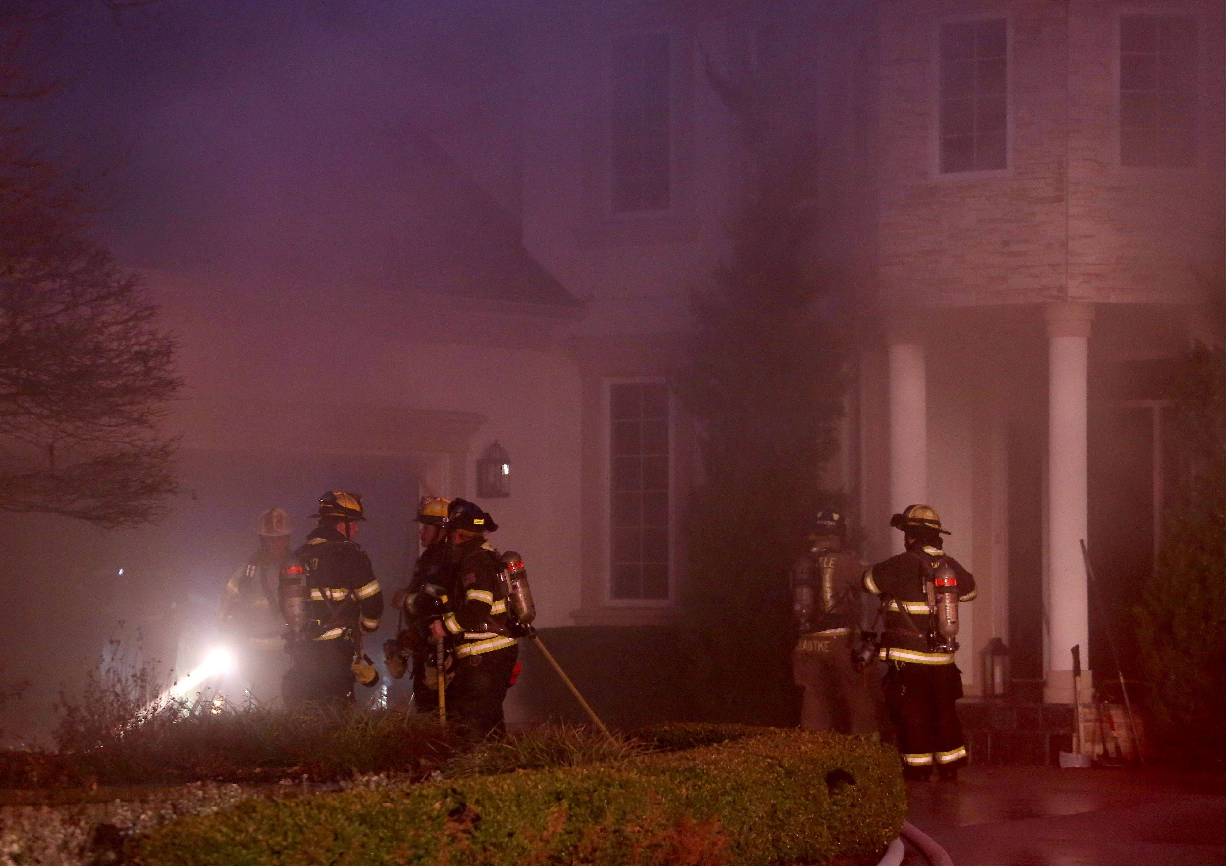 Three firefighters suffered minor injuries Tuesday night while battling a two-alarm fire that caused severe damage to a house in the Steeple Run neighborhood near Naperville. Authorities said the blaze started in the basement and spread rapidly all the way to the attic.