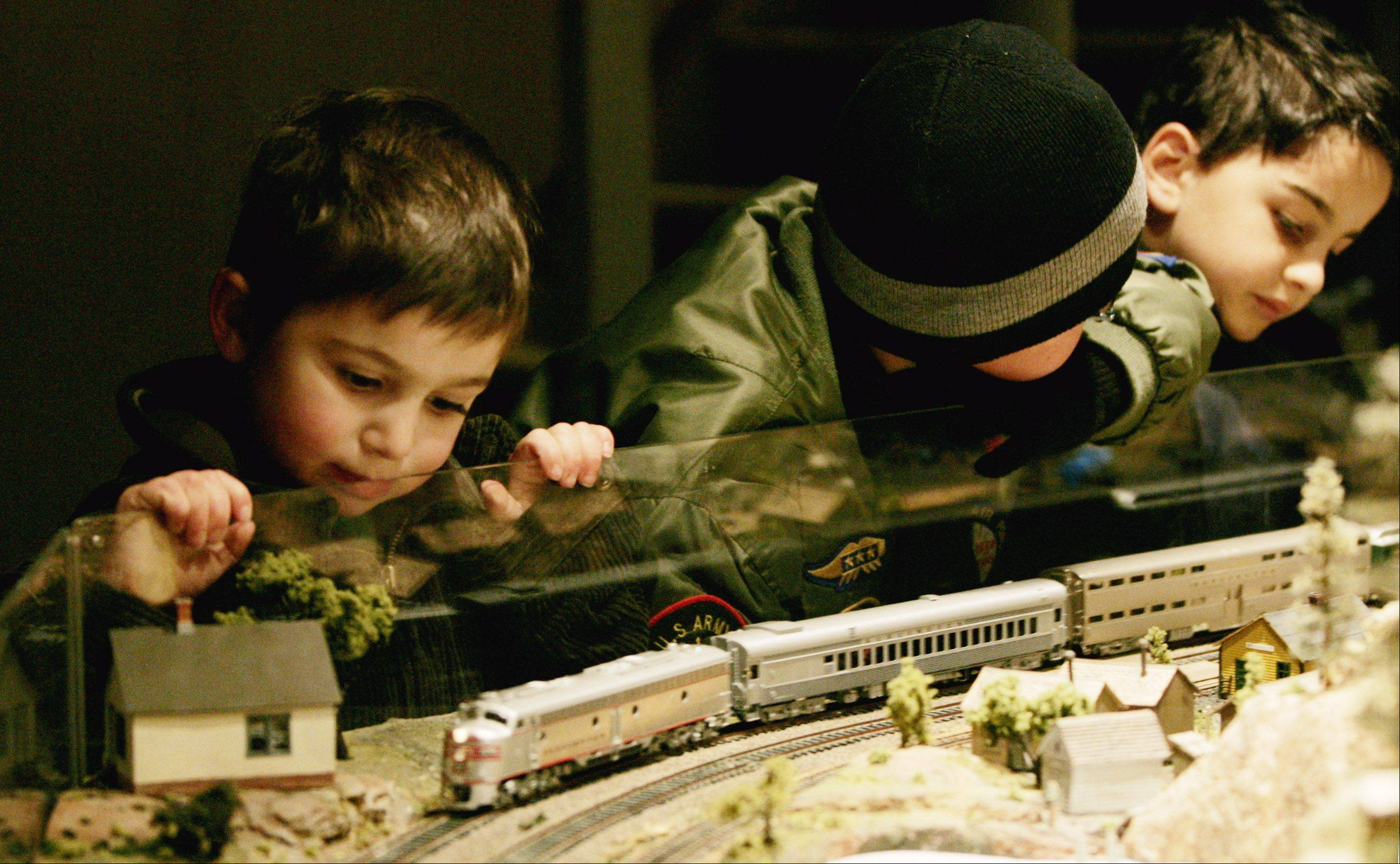 An HO model train display draws railroad fans of all ages during Once Upon a Christmas.
