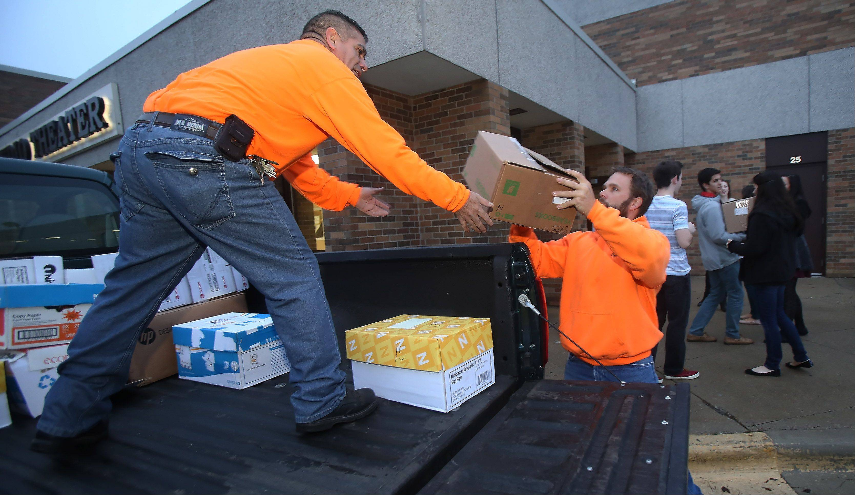 Libertyville Township workers Alex Rodriguez, left, and Chris Slago load a truck with boxes of canned goods with help from Libertyville High School student council members Wednesday morning. The school collected canned goods, paper goods and toiletries and monetary donations for the township food pantry, the Maristella organization and St. Lawrence Church.