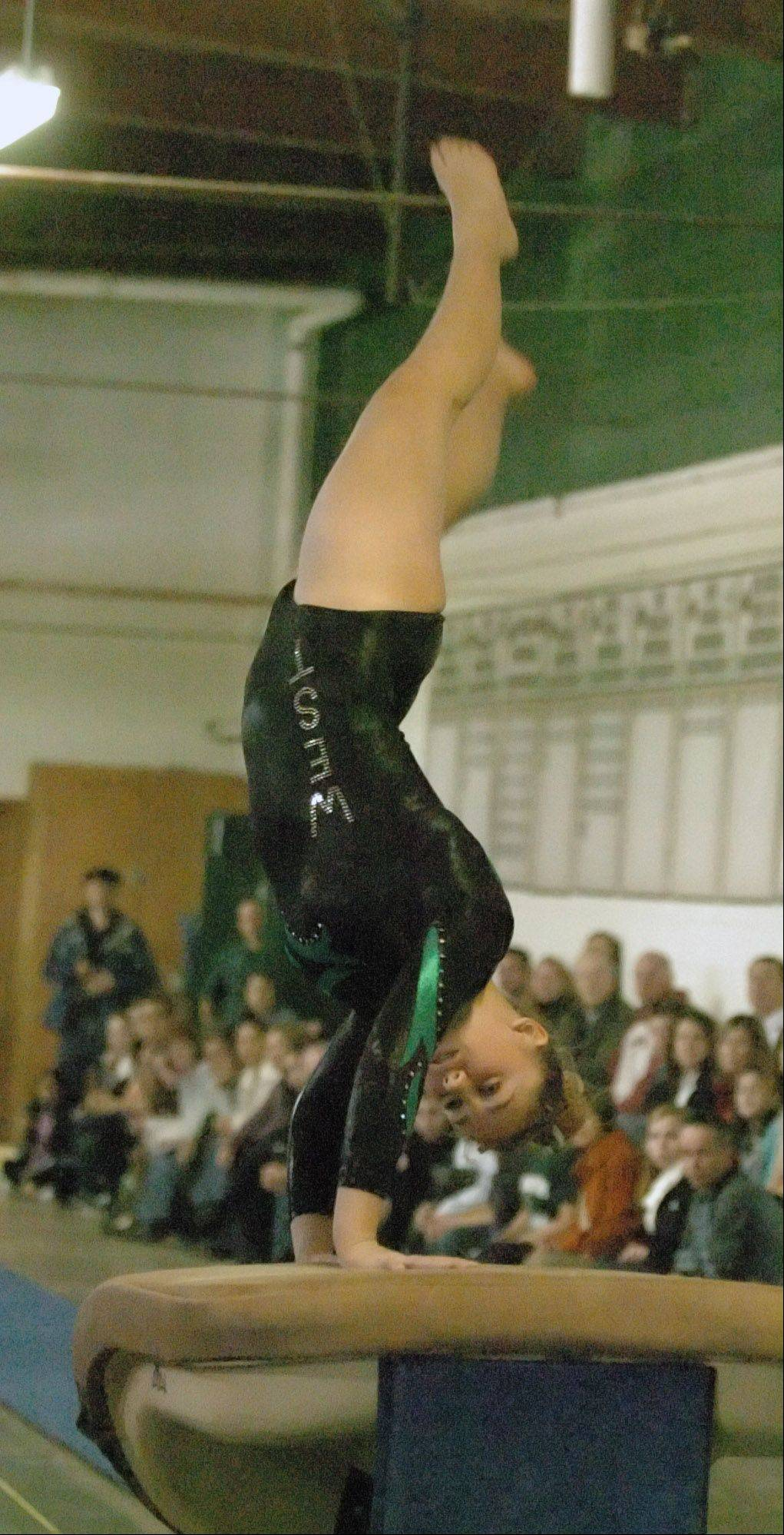 Sarah DeStefano competes on the vault during the DeKalb at Glenbard West girls gymnastics meet Wednesday.