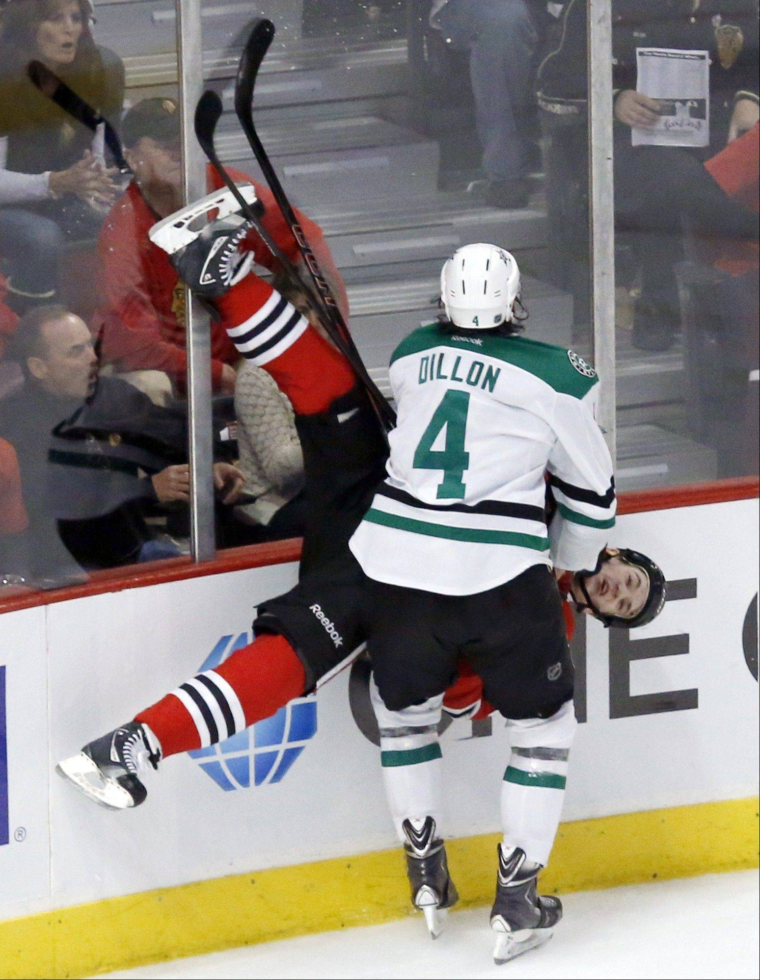 This check by Stars defenseman Brenden Dillon against Andrew Shaw in the third period of Tuesday's 4-3 loss will keep the Blackhawks center out of action today in Minnesota against the Wild.