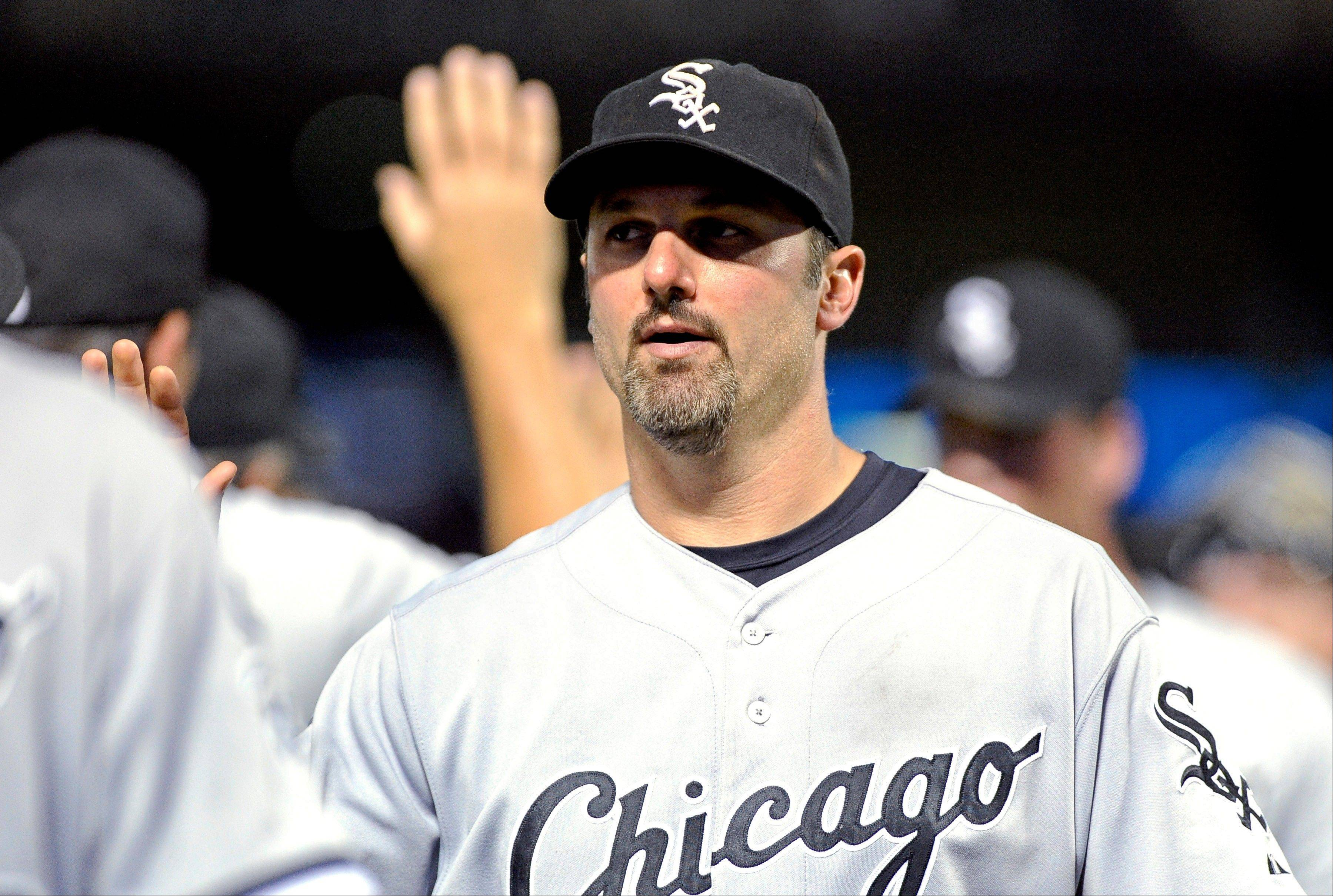 White Sox first baseman Paul Konerko high-fives with teammates after the final out of a baseball game against the Texas Rangers, Saturday, July 28, 2012, in Arlington, Texas. The Chicago White Sox won 5-2.