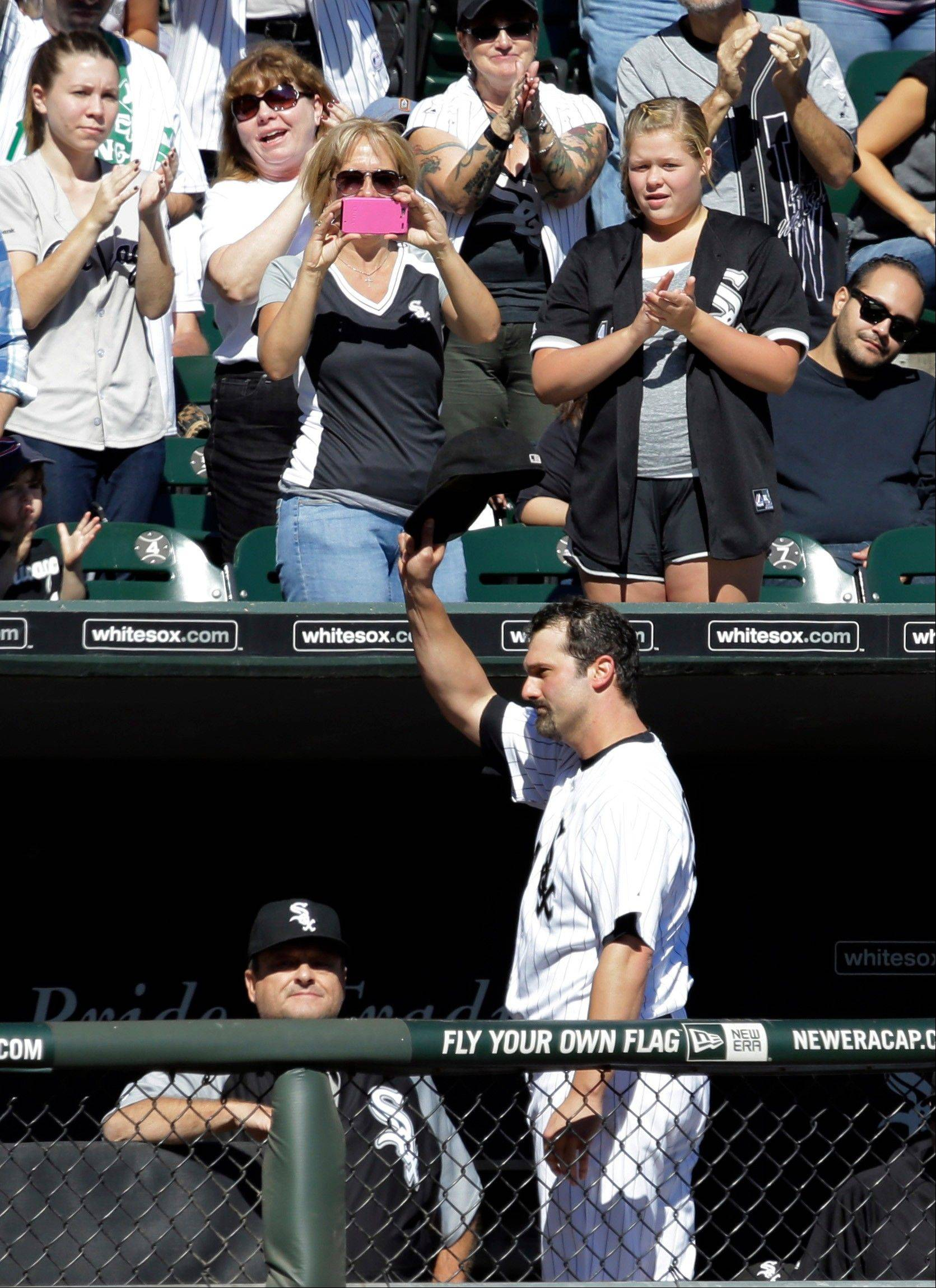White Sox's Paul Konerko waves to fans after Conor Gillaspie replaced him during the second inning of a baseball game against the Kansas City Royals in Chicago, Sunday, Sept. 29, 2013.