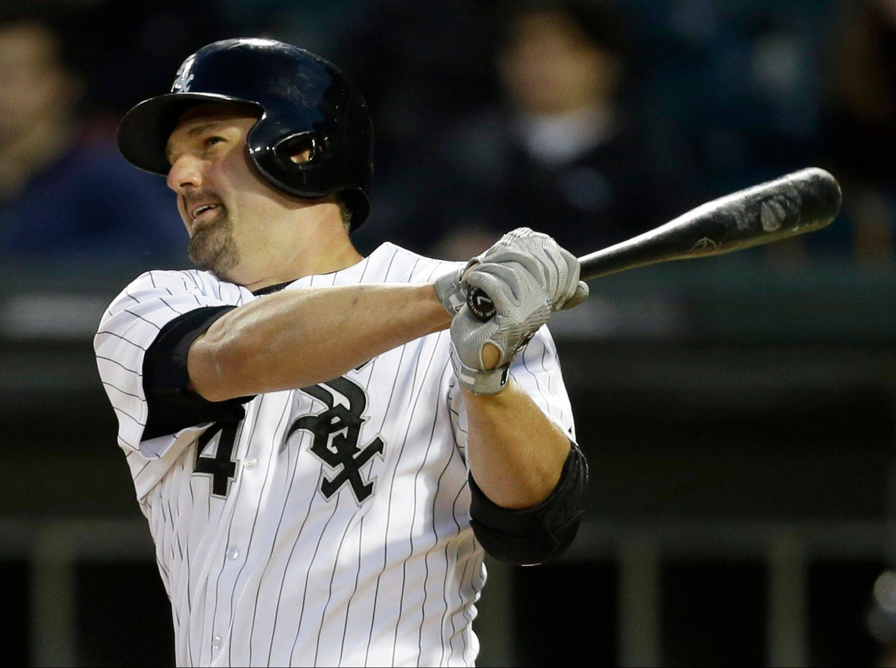 Paul Konerko hits a single during the fifth inning of an interleague baseball game against the Miami Marlins, Friday, May 24, 2013, in Chicago.