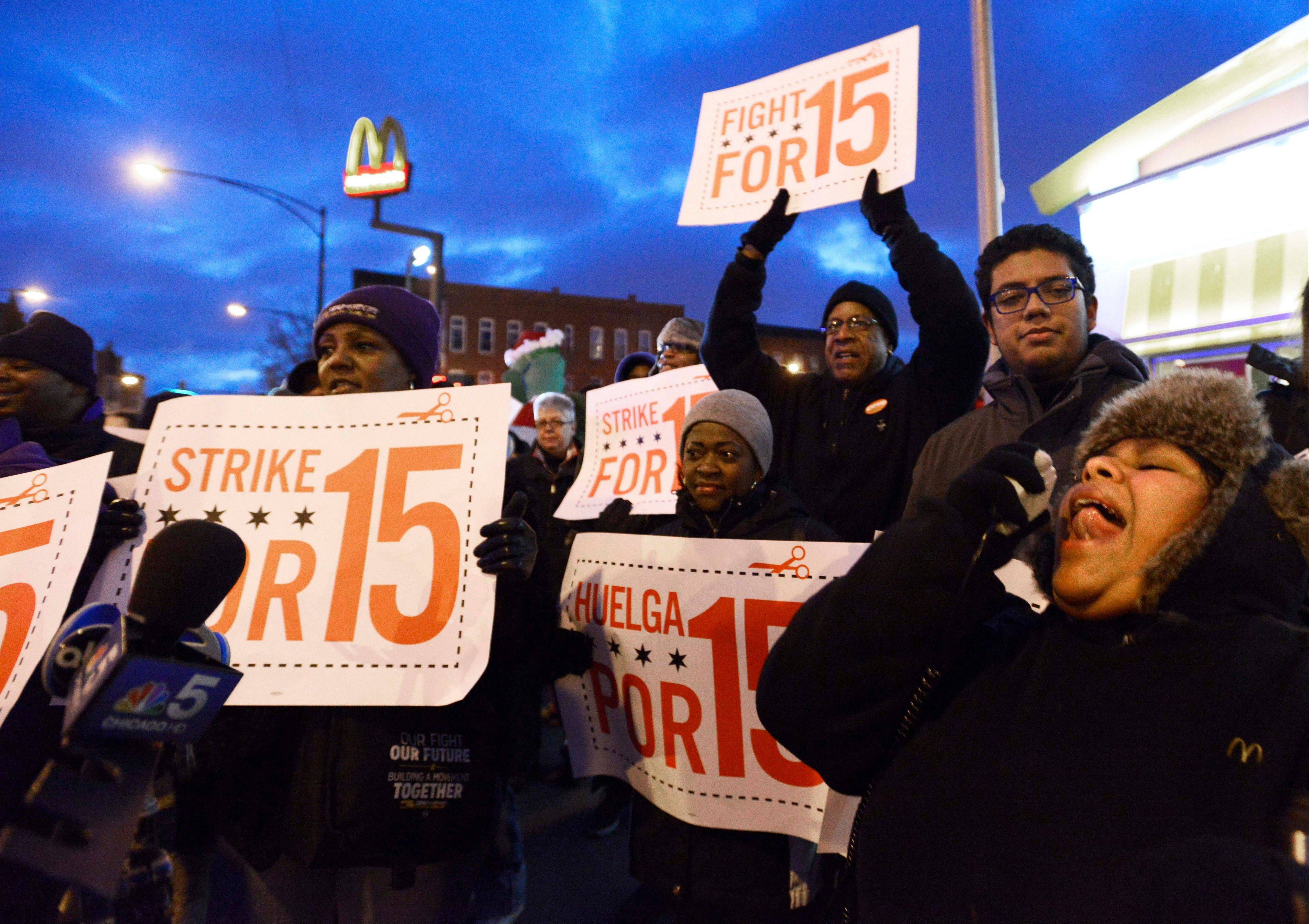 Demonstrators rally for better wages outside a McDonalds in Chicago Thursday, when fast-food workers and labor organizers turned out in support of higher wages in cities across the country.