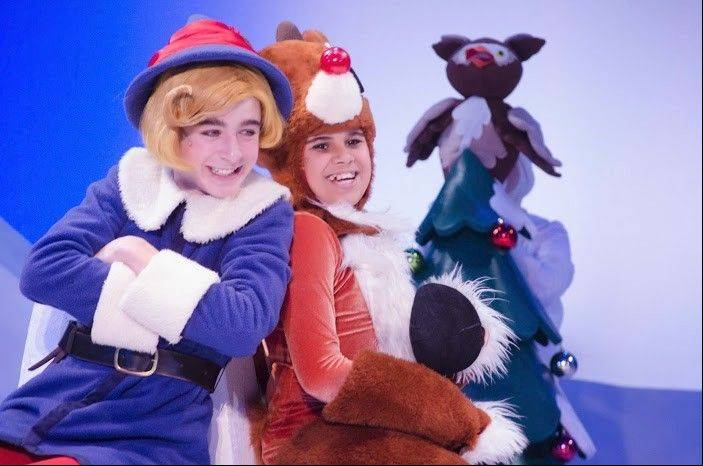 "Arlington Heights fifth grader Cody Bolithon, center, gets to sing, dance and lead Santa's sleigh in ""Rudolph the Red-Nosed Reindeer: The Musical."""