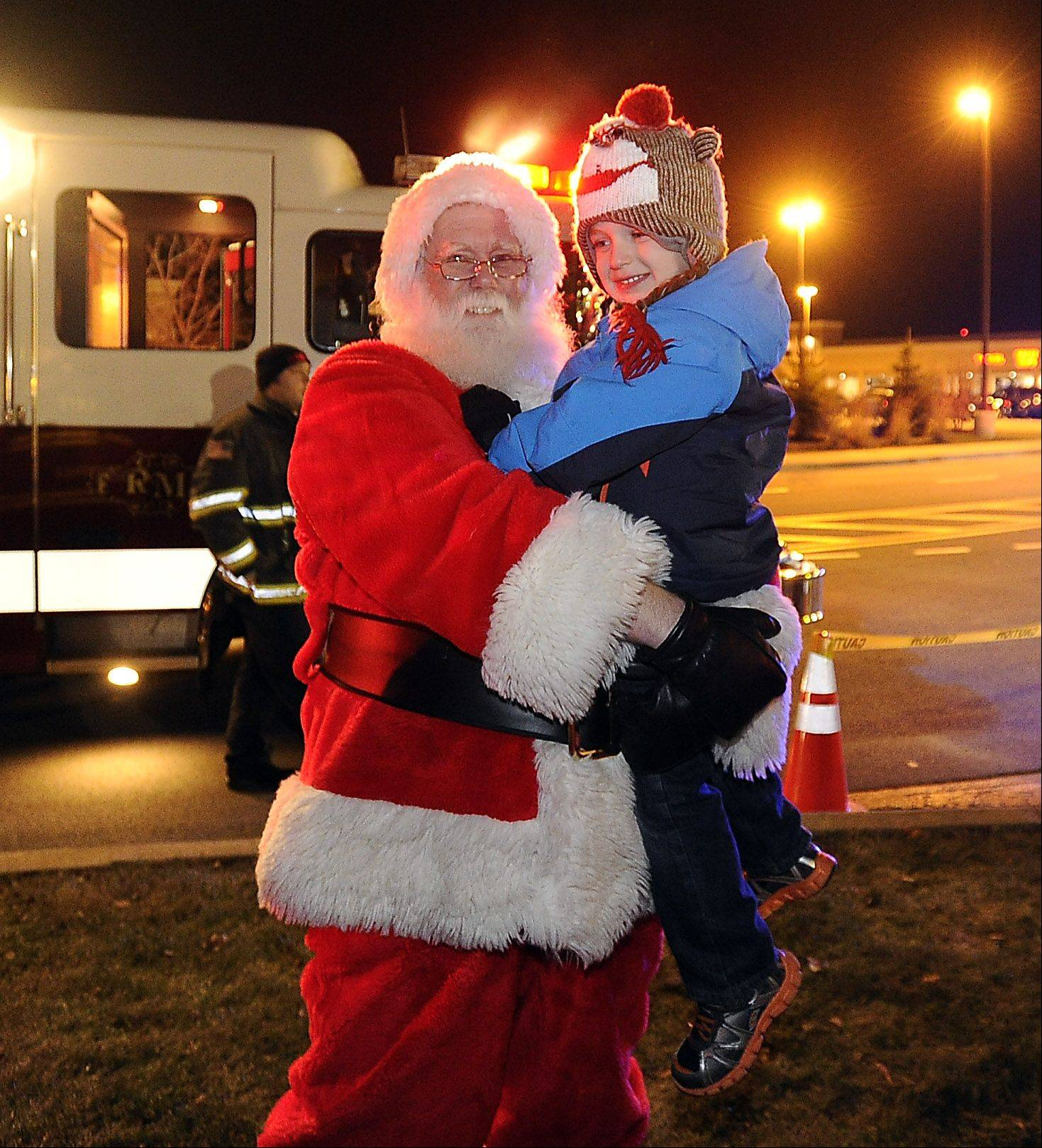 Jackson Maloney, 3, of Rolling Meadows was first to greet Santa Thursday during the city�s tree-lighting event.