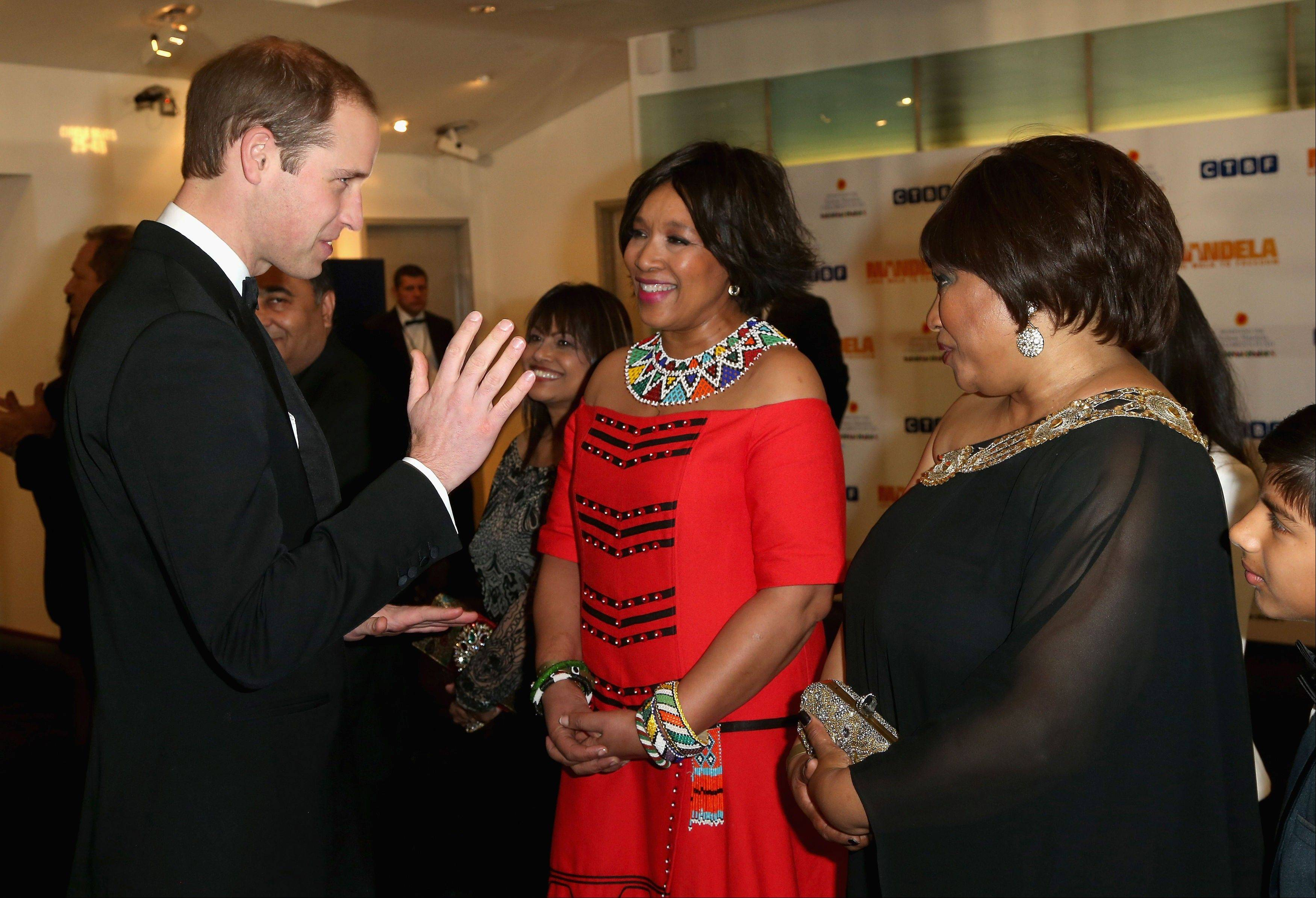 Britain�s Prince William, Duke of Cambridge, meets Zindzi Mandela, right, daughter of former South African President, Nelson Mandela, as they attend the Royal Film Performance of �Mandela: Long Walk to Freedom,� in London on Thursday.