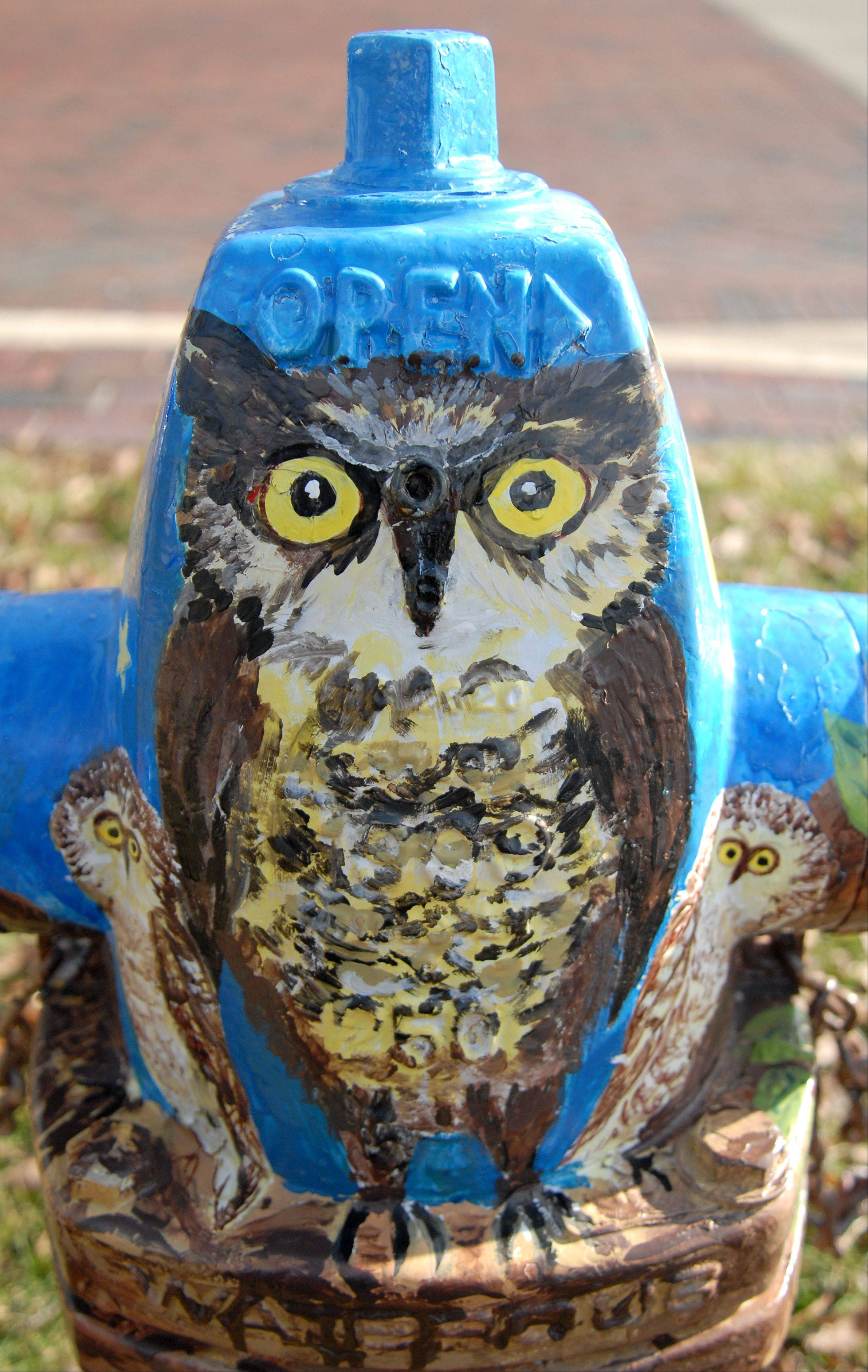Tia Holinger took first place with her �Courthouse Owls� in the �Art on Fire� fire hydrant painting contest in Geneva this summer. Holinger�s artwork is on the hydrant at Third and Fulton streets.
