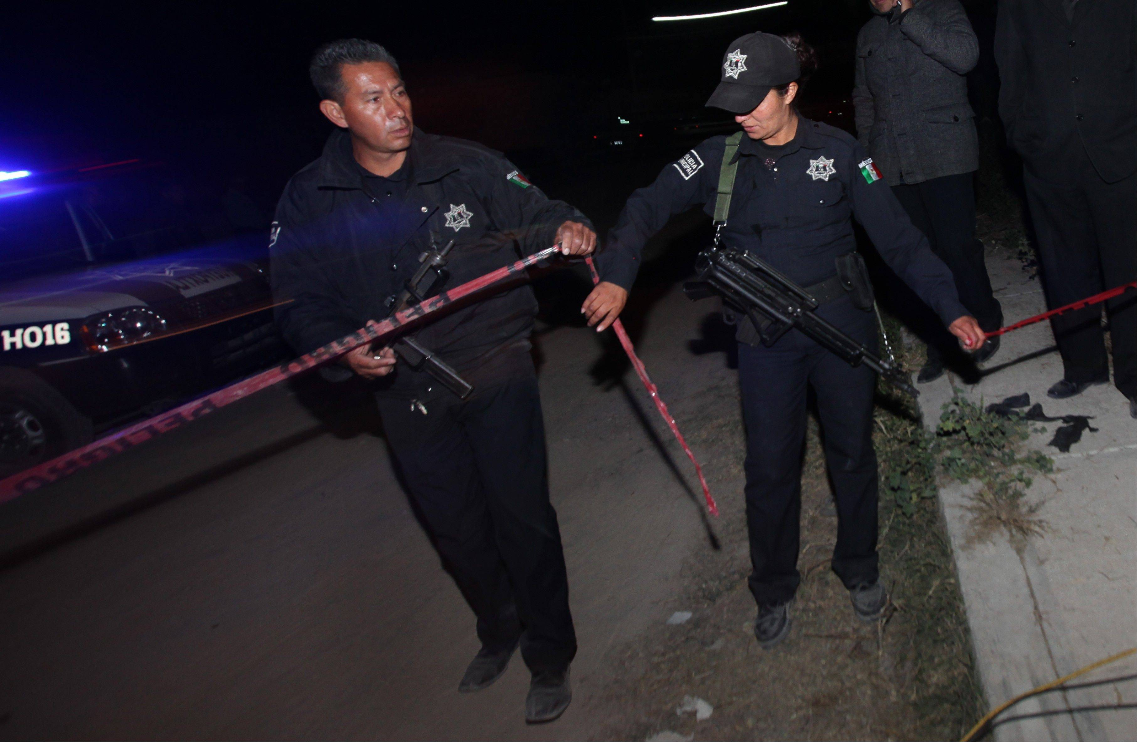 Police agents cordon off an area in the village of Hueypoxtla, Mexico. Mexican troops and federal police kept a nighttime vigil guarding a rural field where thieves abandoned a stolen shipment of highly radioactive cobalt-60, while officials began planning the delicate task of safely recovering the dangerous material.