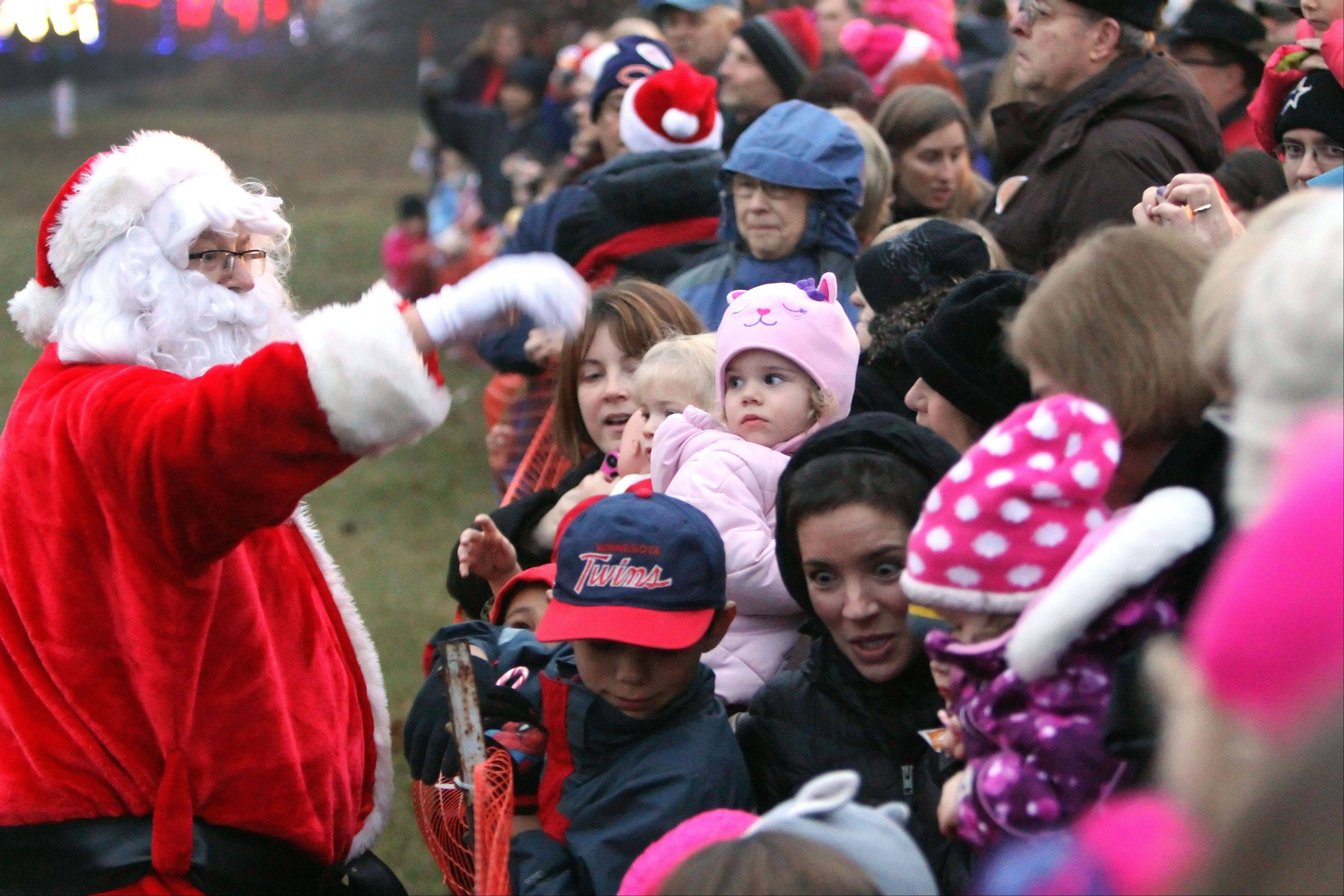 Santa handed out candy canes to children as the 15th annual Canadian Pacific Holiday Train stopped on Depot Road in Gurnee on Wednesday. Food and funds were collected to benefit the Northern Illinois Food Bank.