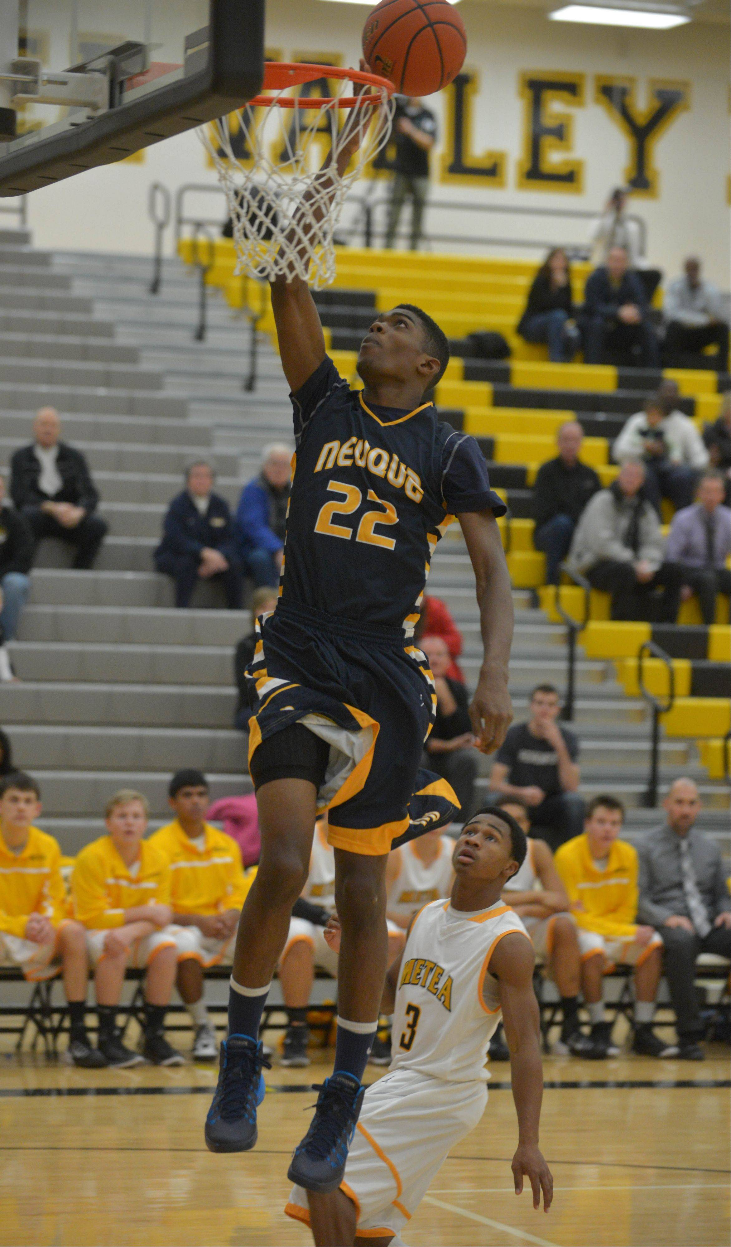 Elijah Robertson of Neuqua Valley takes one to the net during the Neuqua Valley at Metea Valley boys basketball game Thursday.
