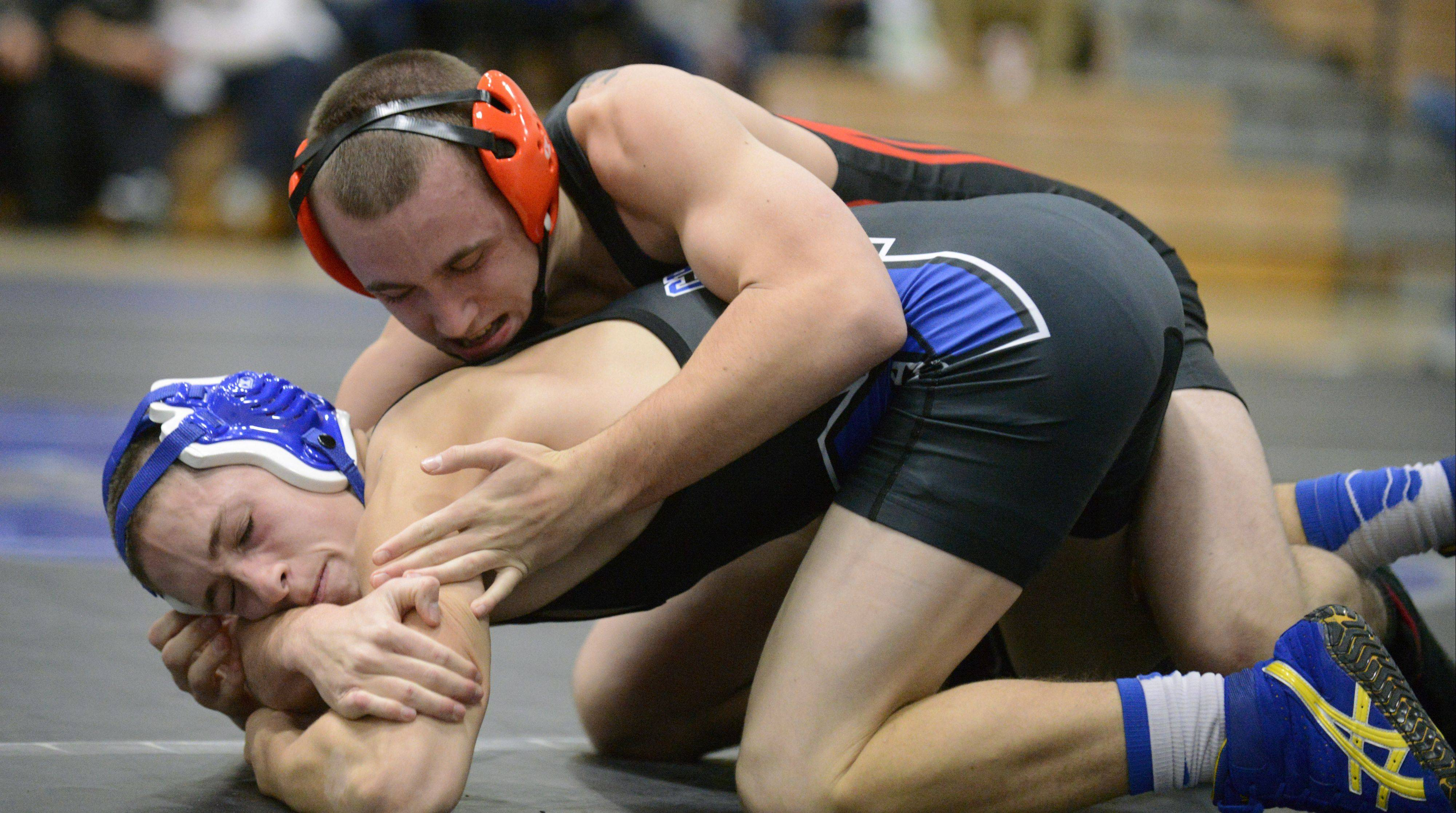 St. Charles East�s Austin Hrubec opened his season beating St. Charles North�s Ray Rushing.