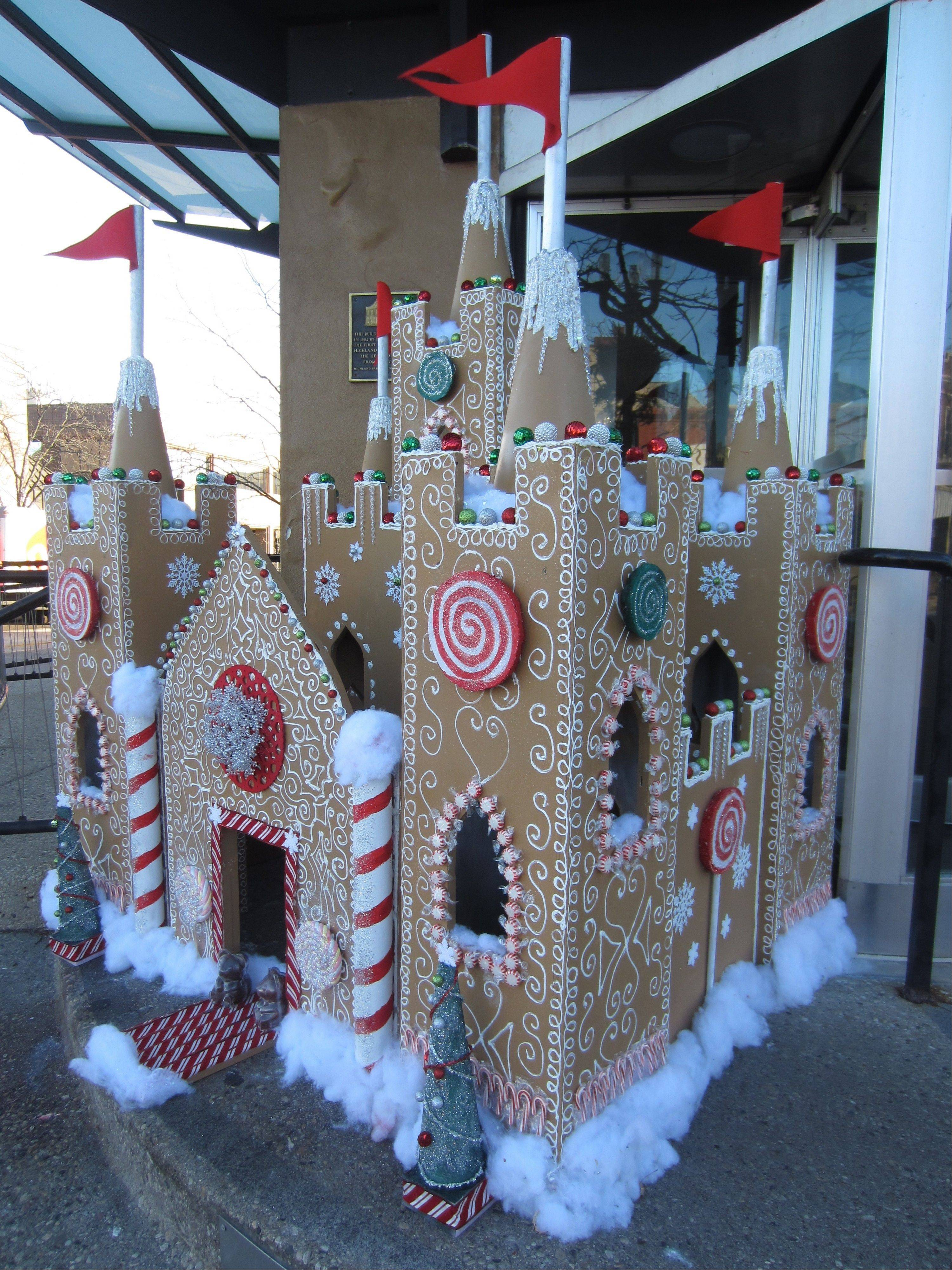 A gingerbread house is among the decoration in Downtown Highland Park's Winter Wonderland, with carriage rides, unique shops, live reindeer and other holiday festivities, Dec. 14.