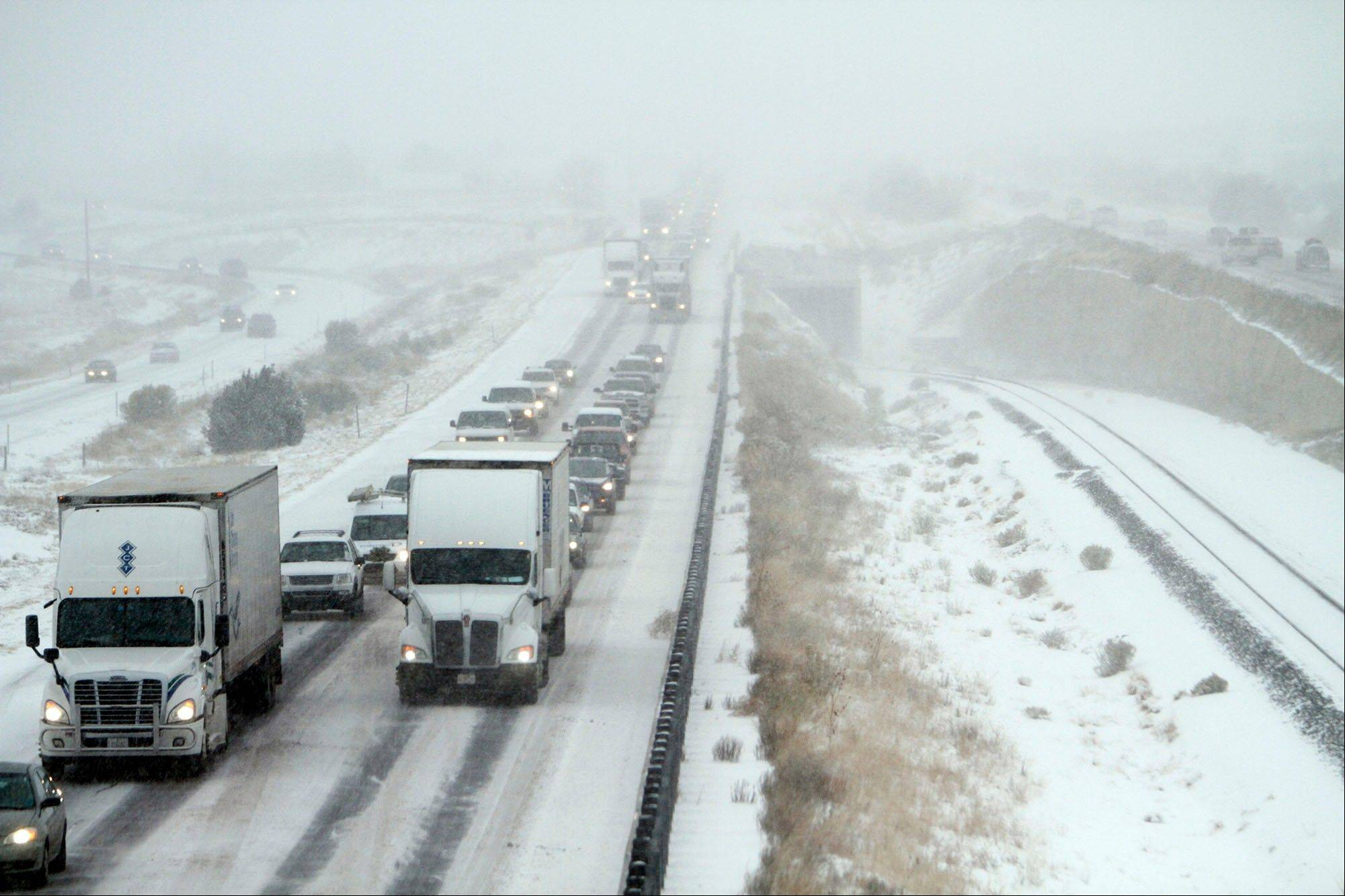 Traffics is backed up on highway I-25 after a winter storm system swept through Thursday, Dec. 5, 2013, in La Bajada, N.M.