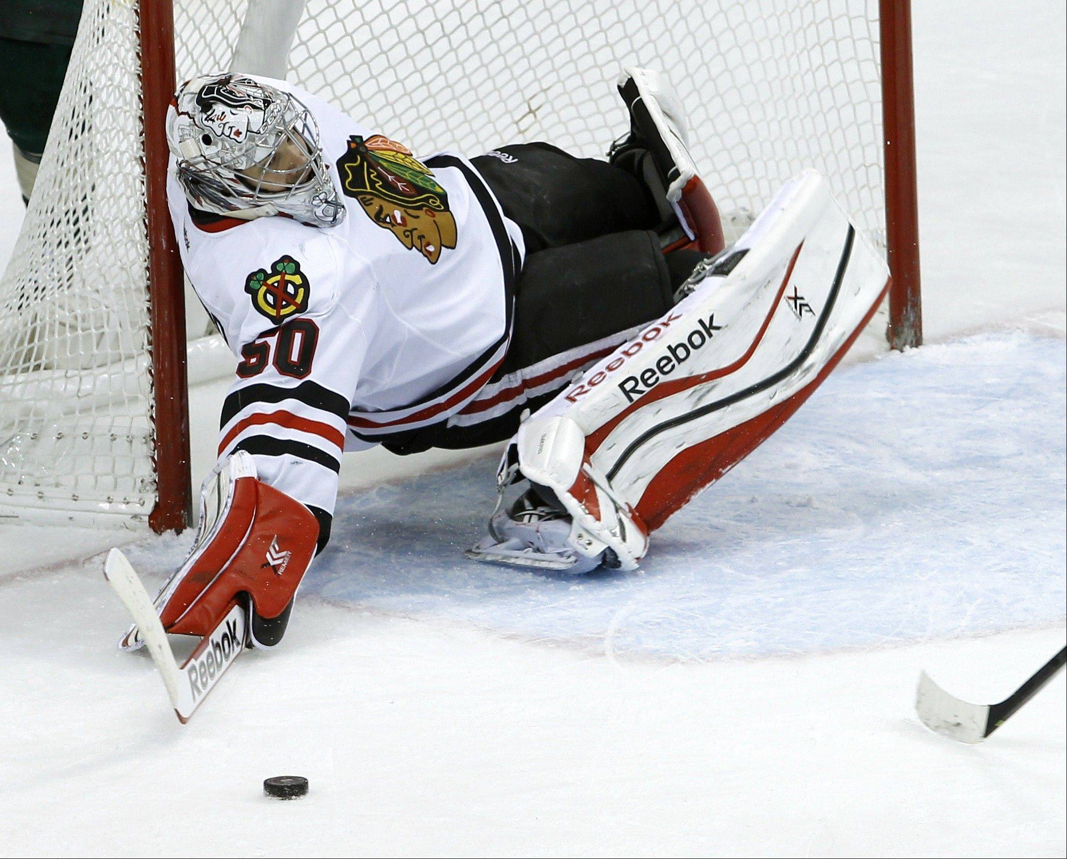 Associated PressBlackhawks goalie Corey Crawford (50) falls over backwards to stop a shot by the Minnesota Wild during the third period of an NHL hockey game in St. Paul, Minn., Thursday. The Wild beat the Blackhawks 4-3.