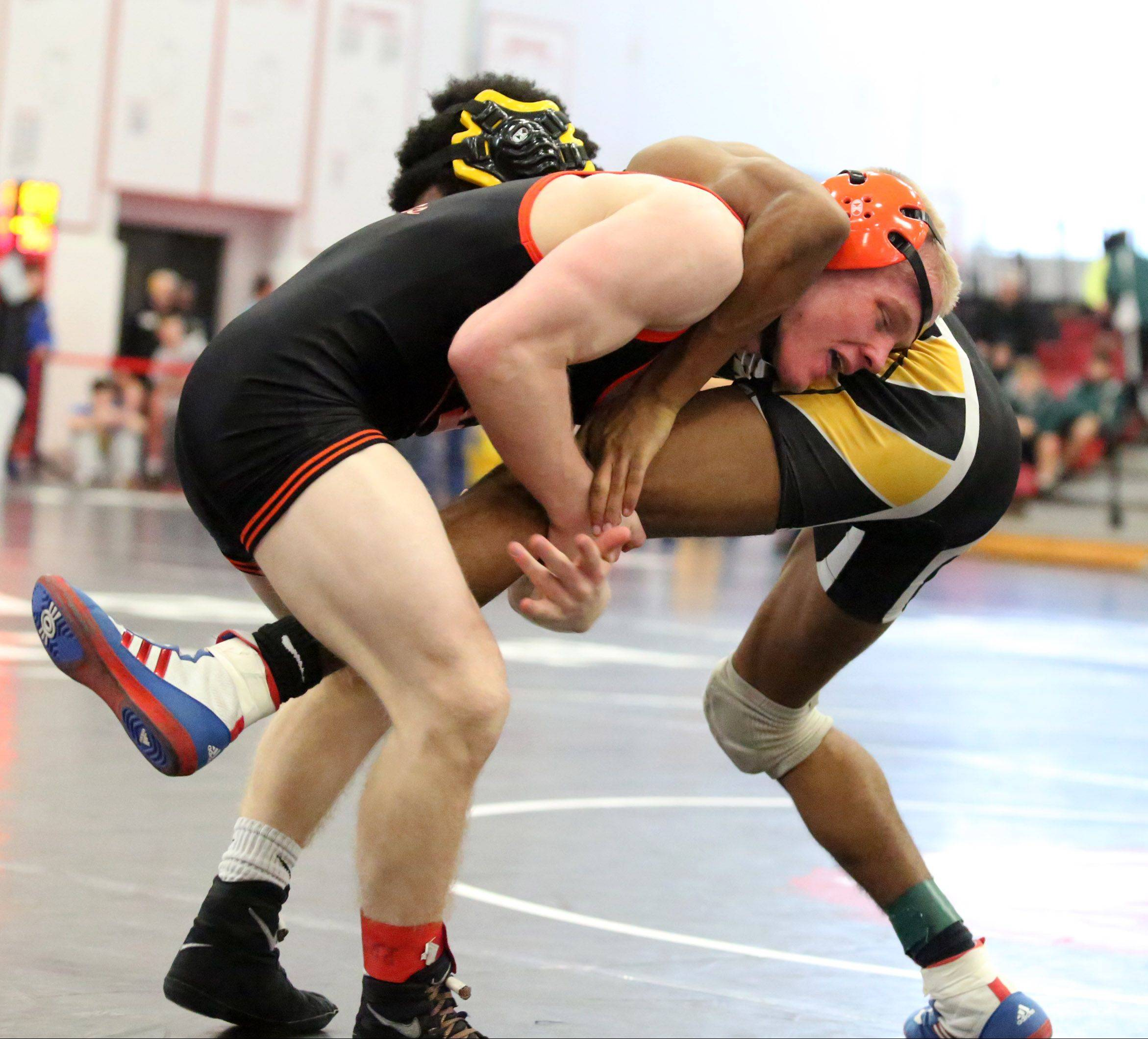 Libertyville's Minnesota-bound Steve Polakowski, left, wrestles Joliet West's Jared Sims in the 120-pound semifinals at the 23rd annual Moore/Prettyman tournament at Barrington last Saturday.