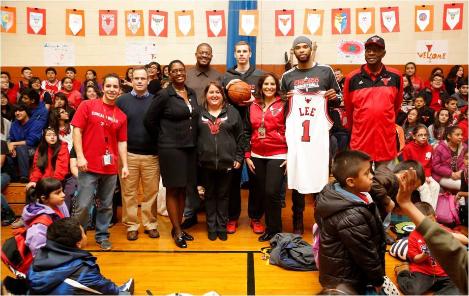 Chicago Bulls players -- Erik Murphy and Taj Gibson join Leslie J. Anderson, SVP, Regional Head of Business Banking, BMO Harris Bank at Richard Henry Lee School's pep rally to celebrate the school's achievement of being selected as the 2013-2014 Adopt-A-School partner for this school year.