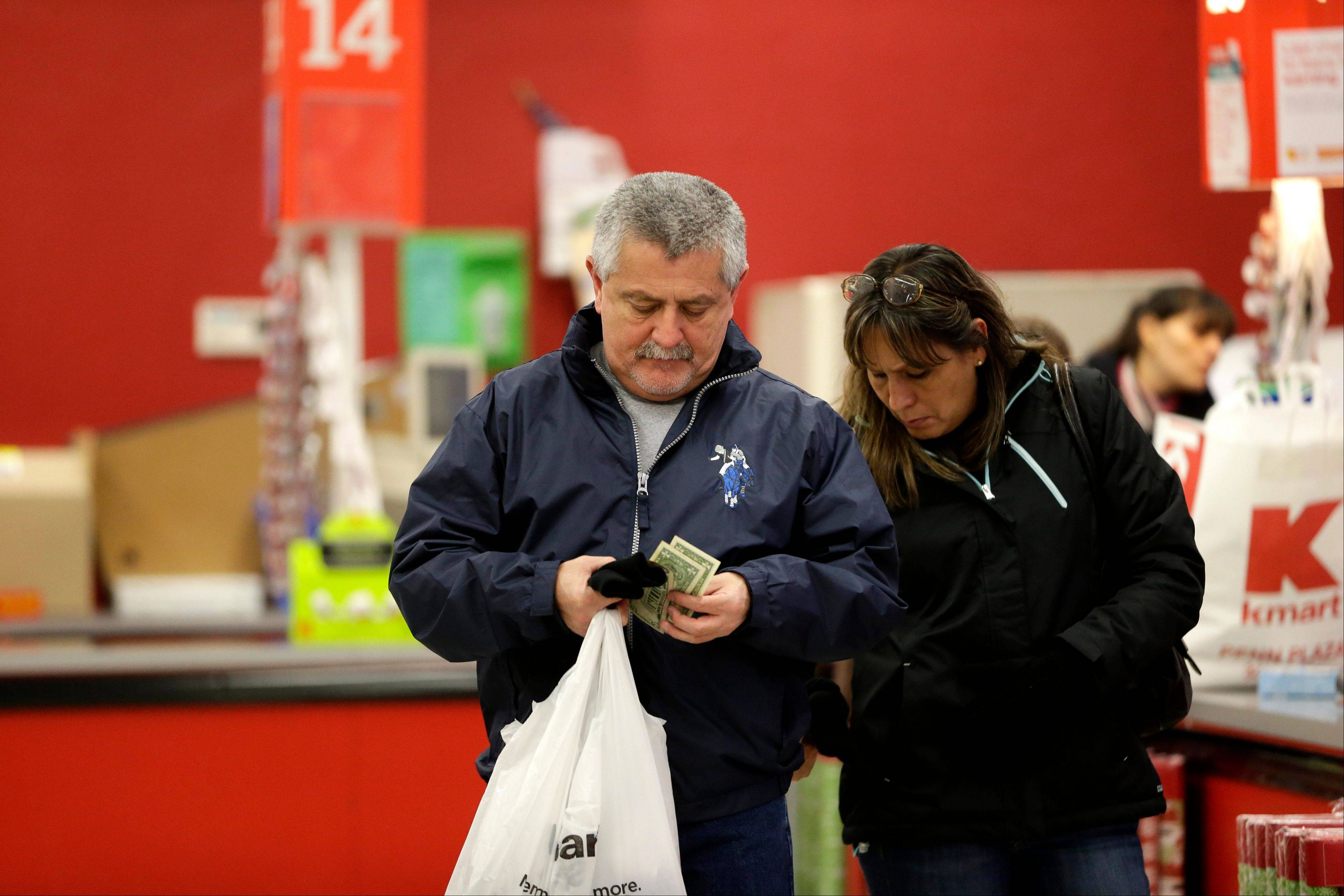 U.S. consumers increased their spending in October even though their wages and salaries barely increased, raising questions about how strong the economy will grow at the end of the year.